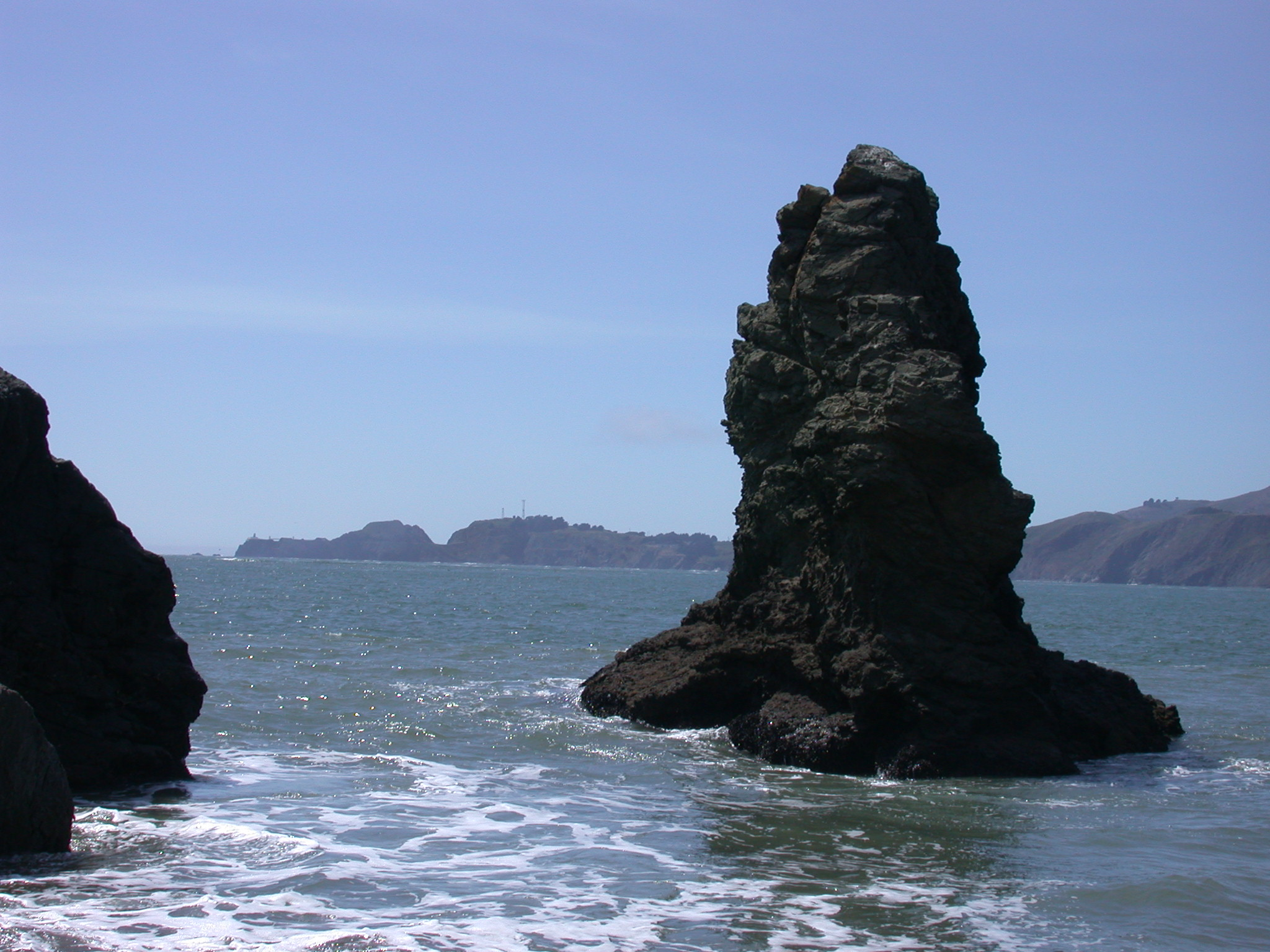Giant Rock Protruding From Pacific Ocean Near Golden Gate Bridge