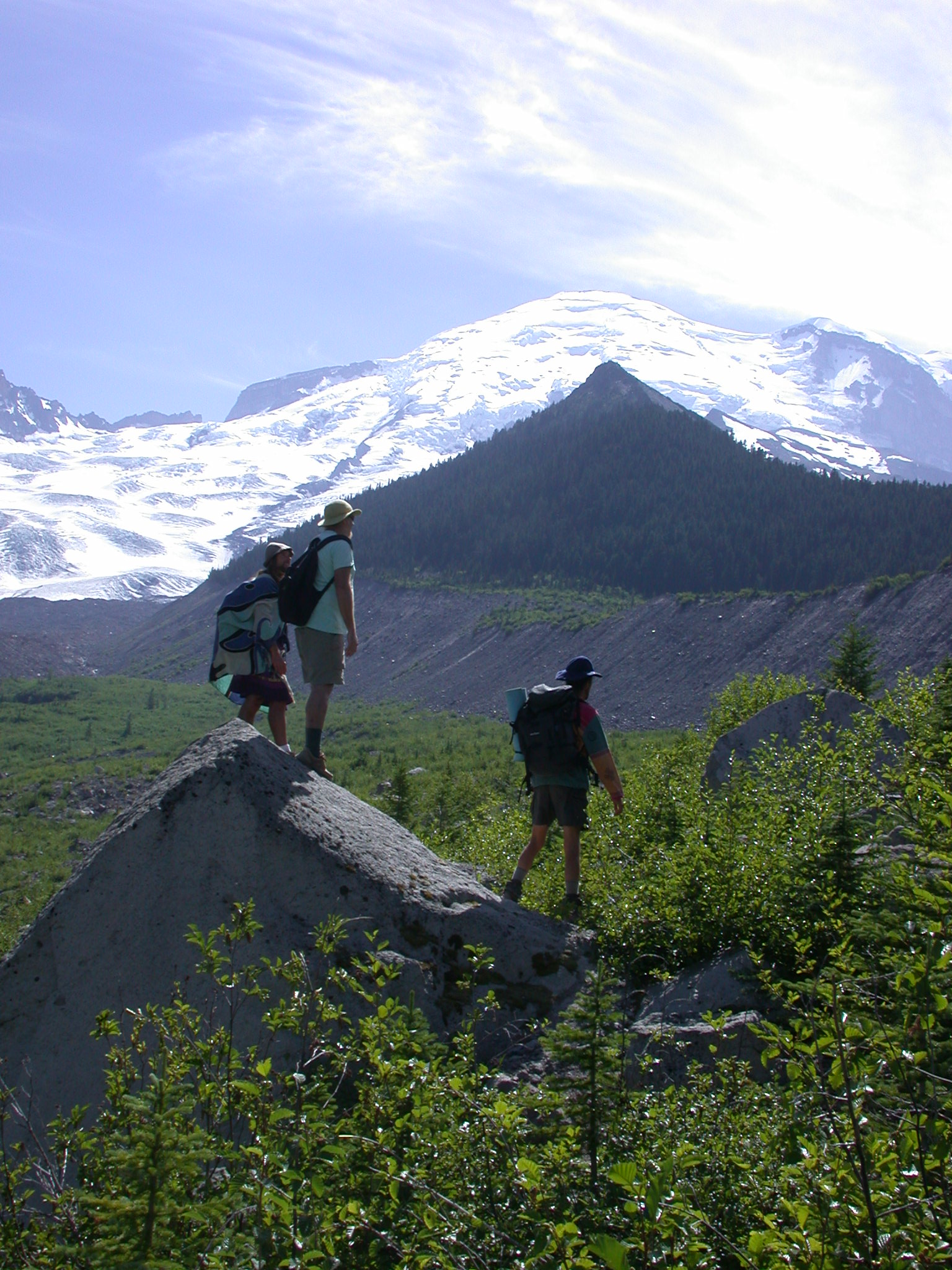 Sierra, Dazzle, and Fruitboy on Glacial Valley Limey Outcrop With View of Pyramid Peak and Mount Rainier Summit