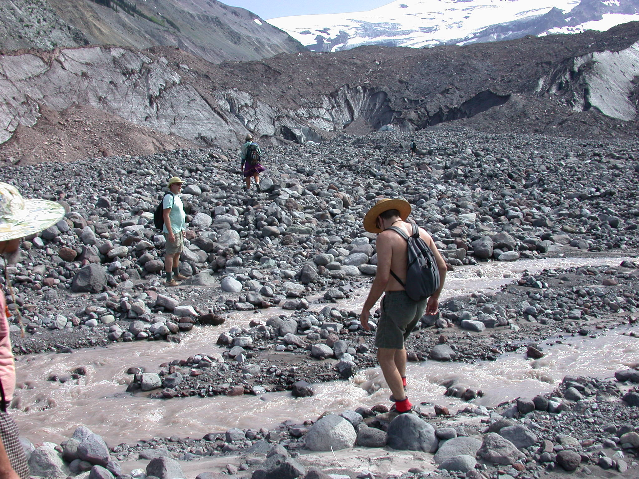 Fruitboy, Dazzle, Tusk, and Mugwort Fording Glacial River on the Way to Glacier Ice Cave on Mount Rainier