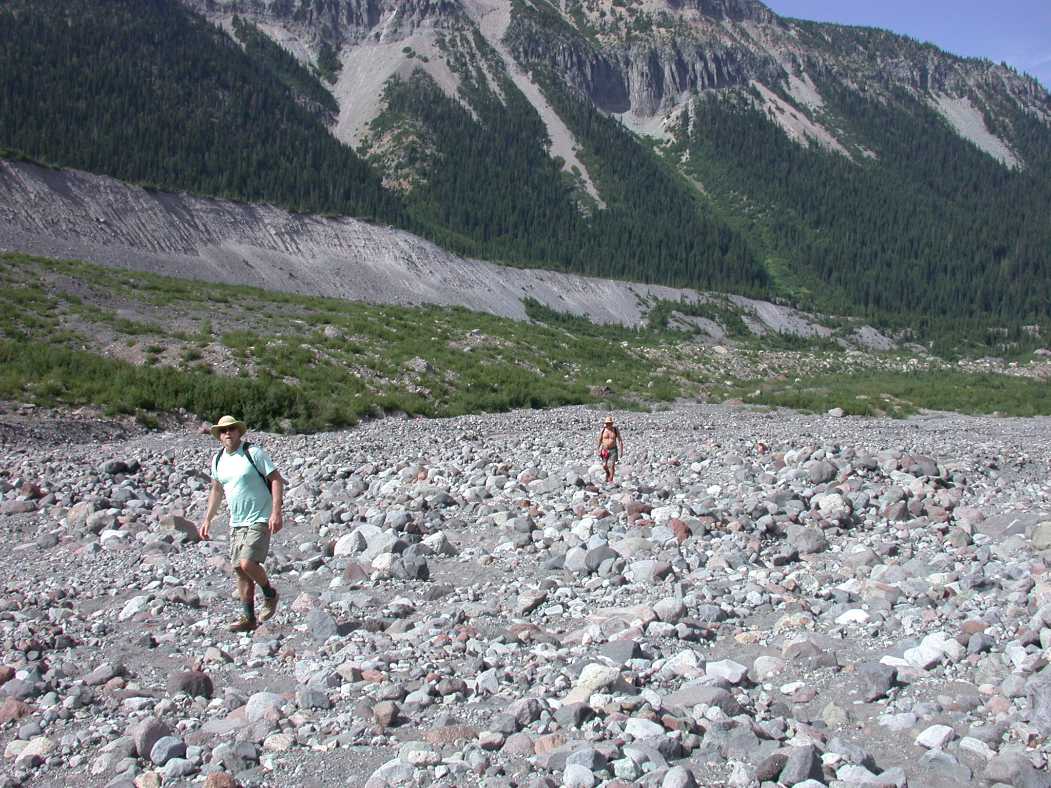 Dazzle and Tusk Traversing Rocky Glacial Valley on Mount Rainier