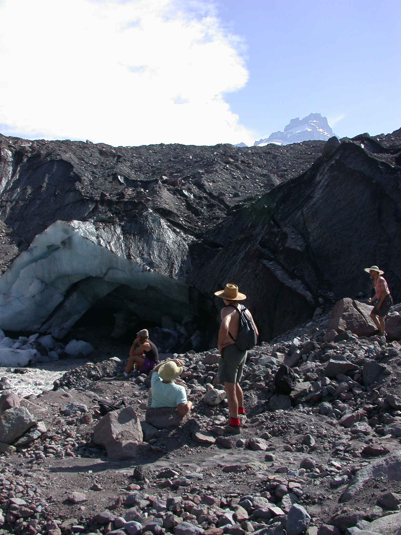 Sierra, Dazzle, Tusk, and Mugwort Watch the Alabaster Ice Cave at the Base of the Glacier on Mount Rainier