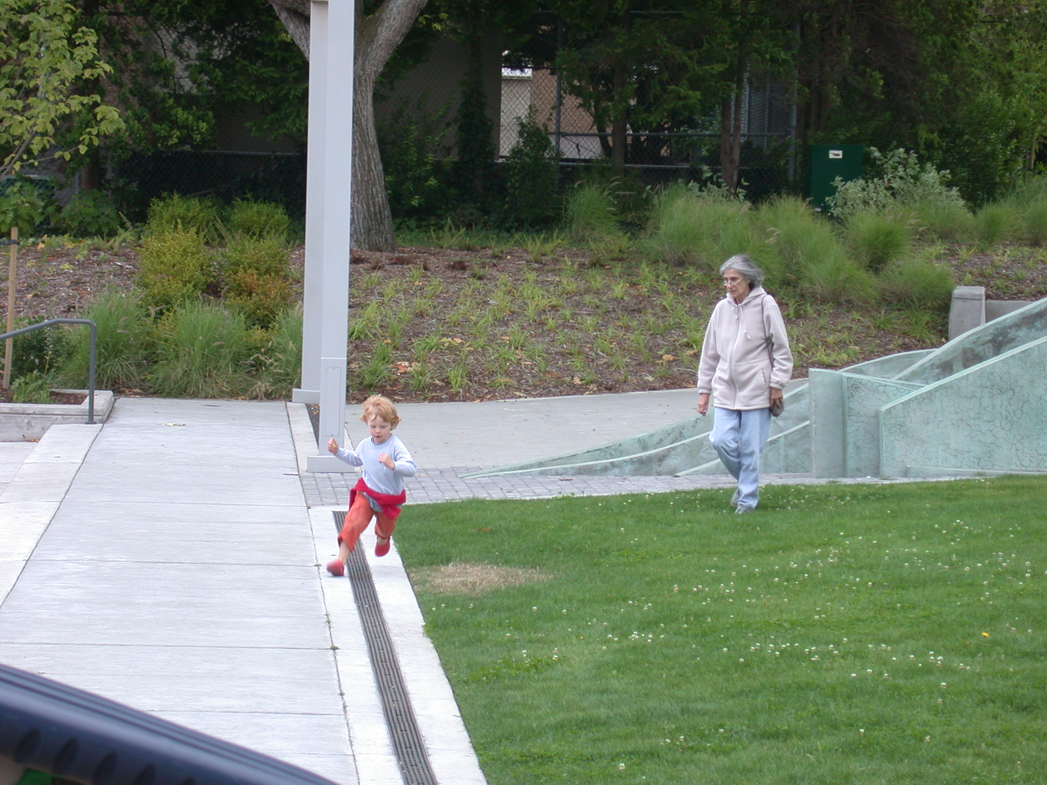 Mom Walking and Zachary Running at Library Playground