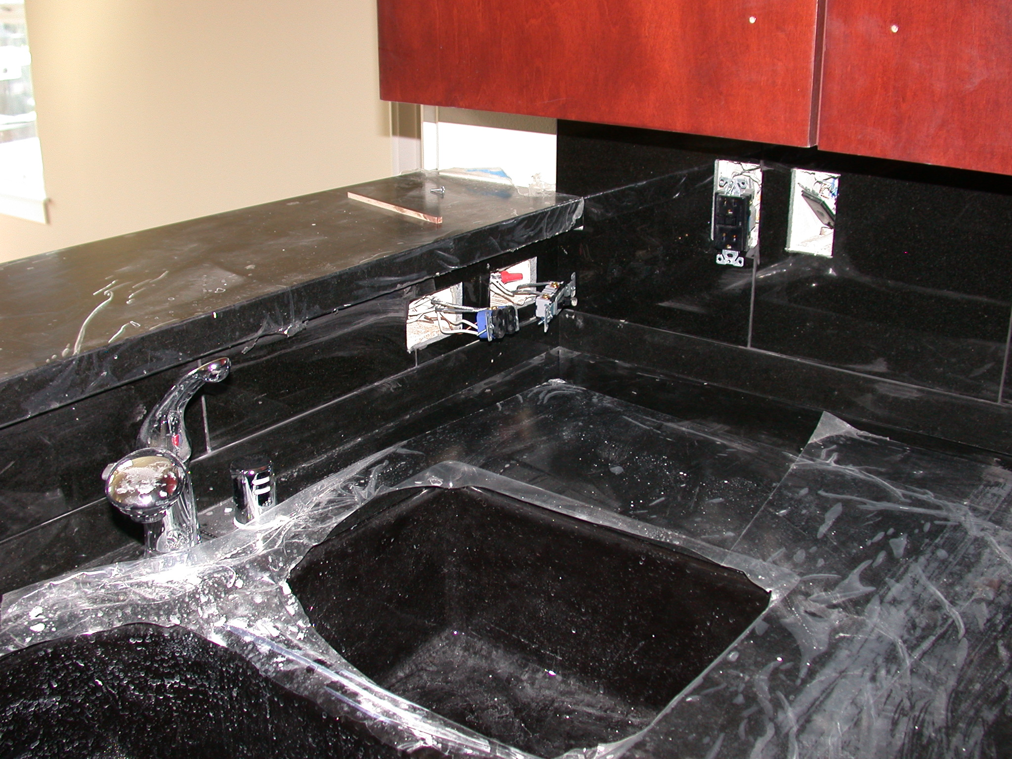 Sink Area in Kitchen of Moms Condominium