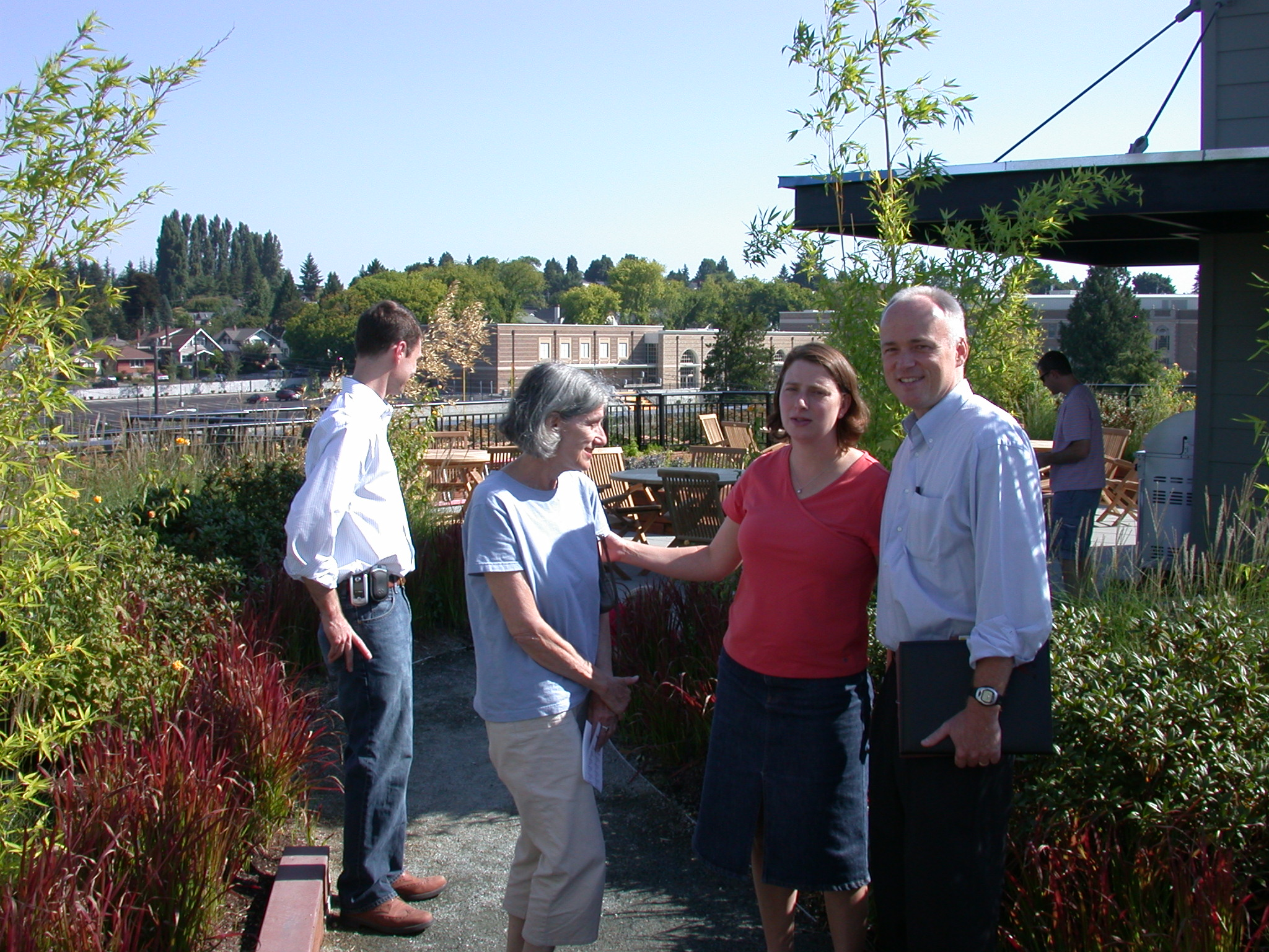 Rob (Selling Agent), Mom, Jen, Mark (Assisting Heiki, Our Agent), and Jim on Rooftop Garden of Moms Condominium Building