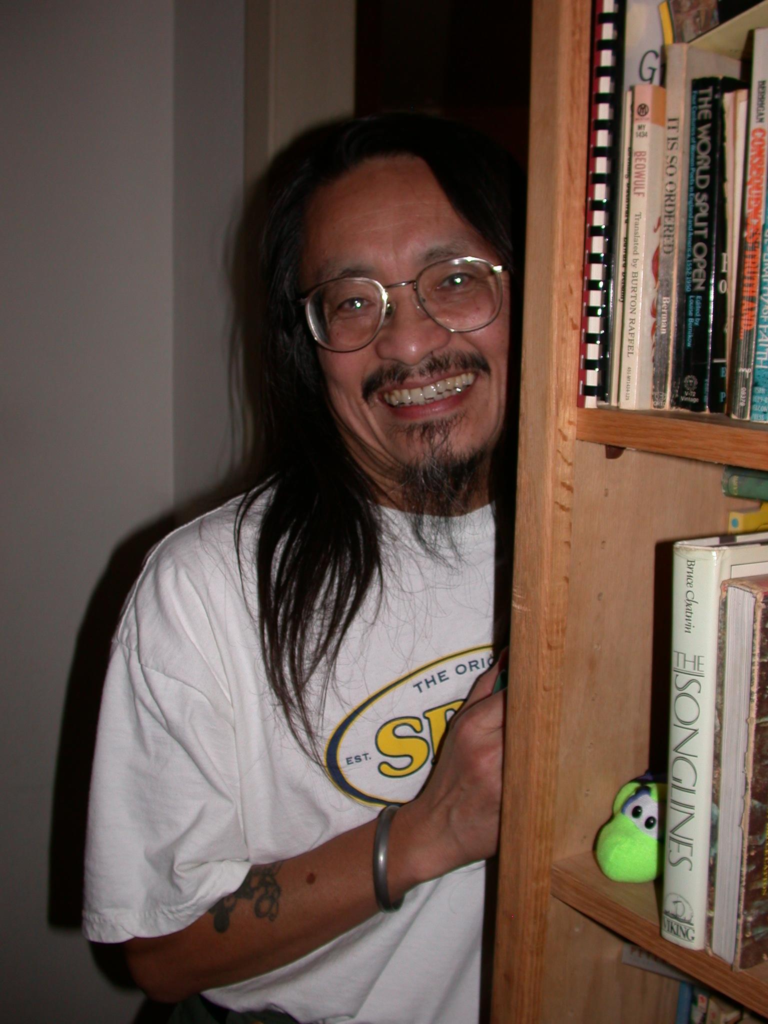 Loren Coy Behind Bookshelf