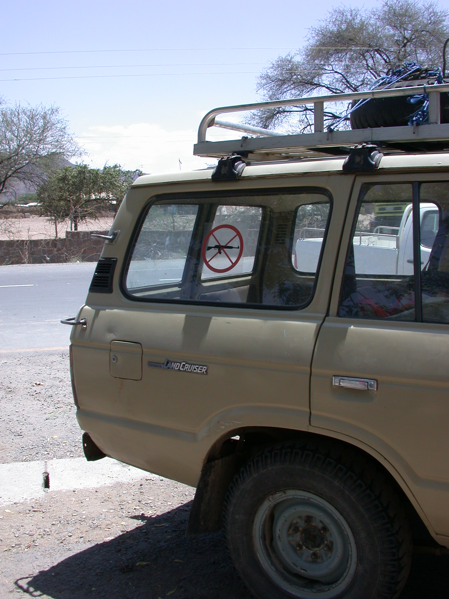 4WD Vehicle With Anti-Gun Sticker on Road from Awash Saba to Addis Ababa, Ethiopia