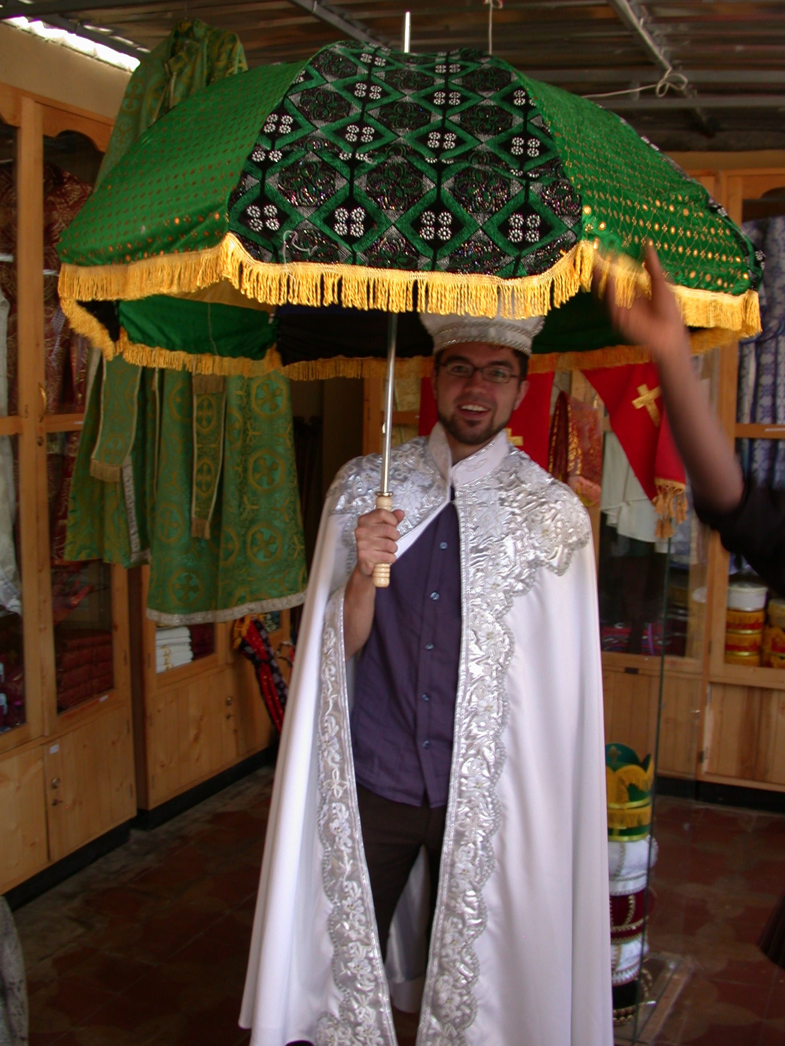 Frederick in Marriage Gown With Umbrella at Church Shop, Addis Ababa, Ethiopia
