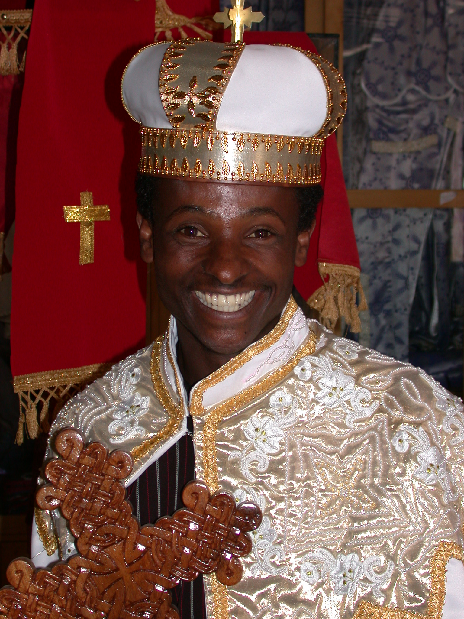 cat 13&paged 6 ethiopian wedding dress Shop Employee With Cross and Guy off Street in Wedding Gowns at Church Shop