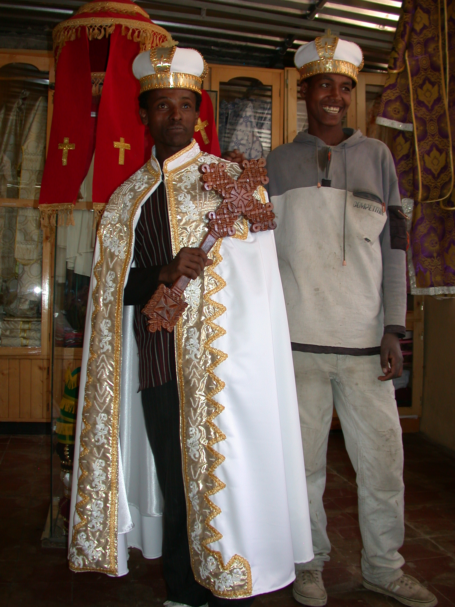 Shop Employee With Cross and Guy off Street in Wedding Gowns at Church Shop, Addis Ababa, Ethiopia