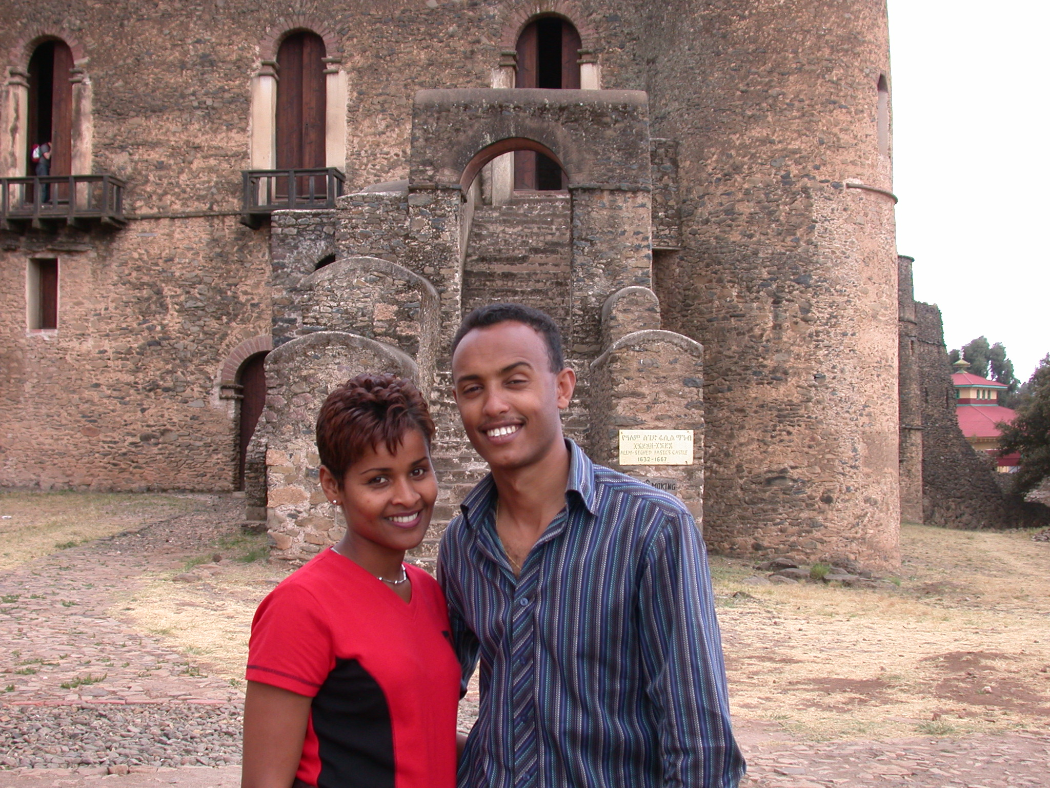 Ethiopian Couple in Front of Palace, Fasil Ghebbi Royal Enclosure, Gonder, Ethiopia