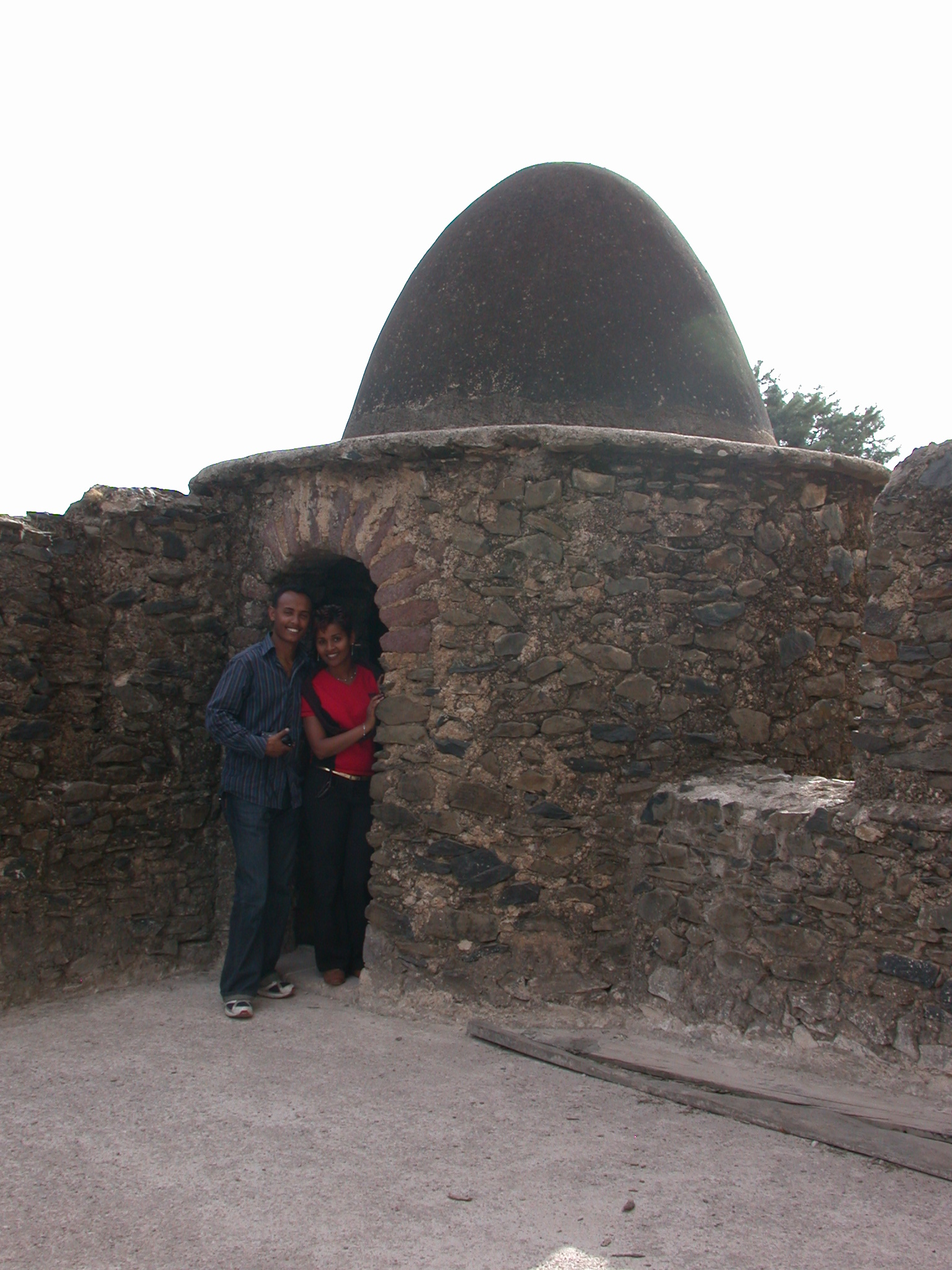 Ethiopian Couple in Front of Egg-Shaped Tower, Fasil Ghebbi Royal Enclosure, Gonder, Ethiopia