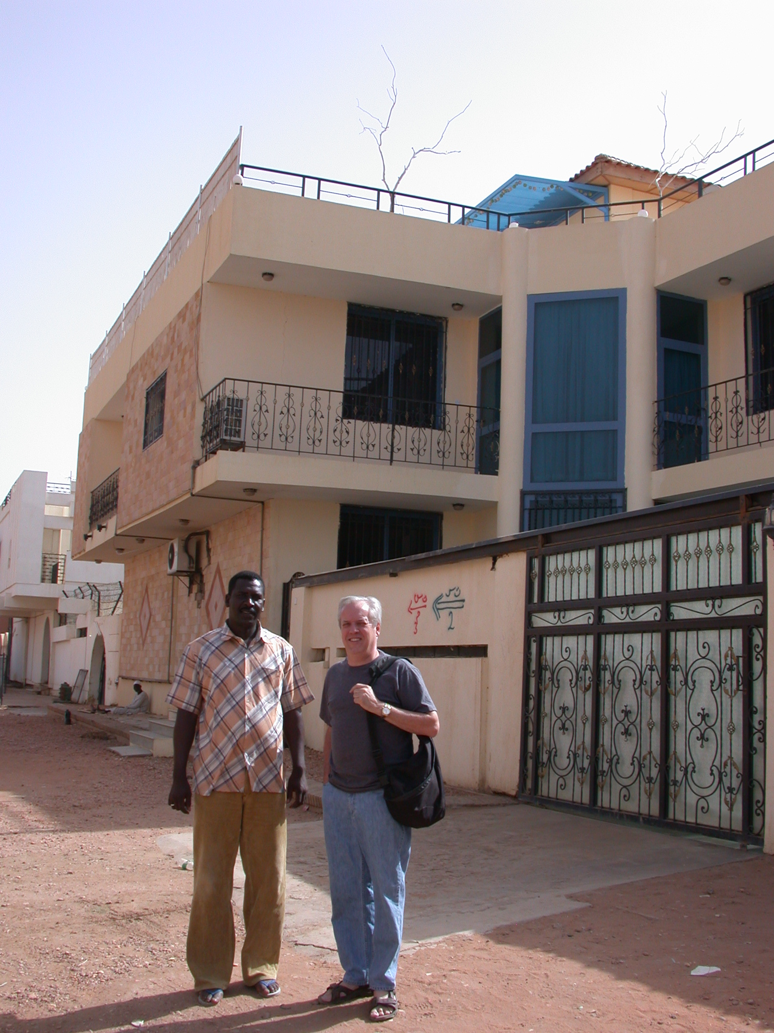 Phil and His Security Guard in Front of His Apartment Building, Khartoum, Sudan