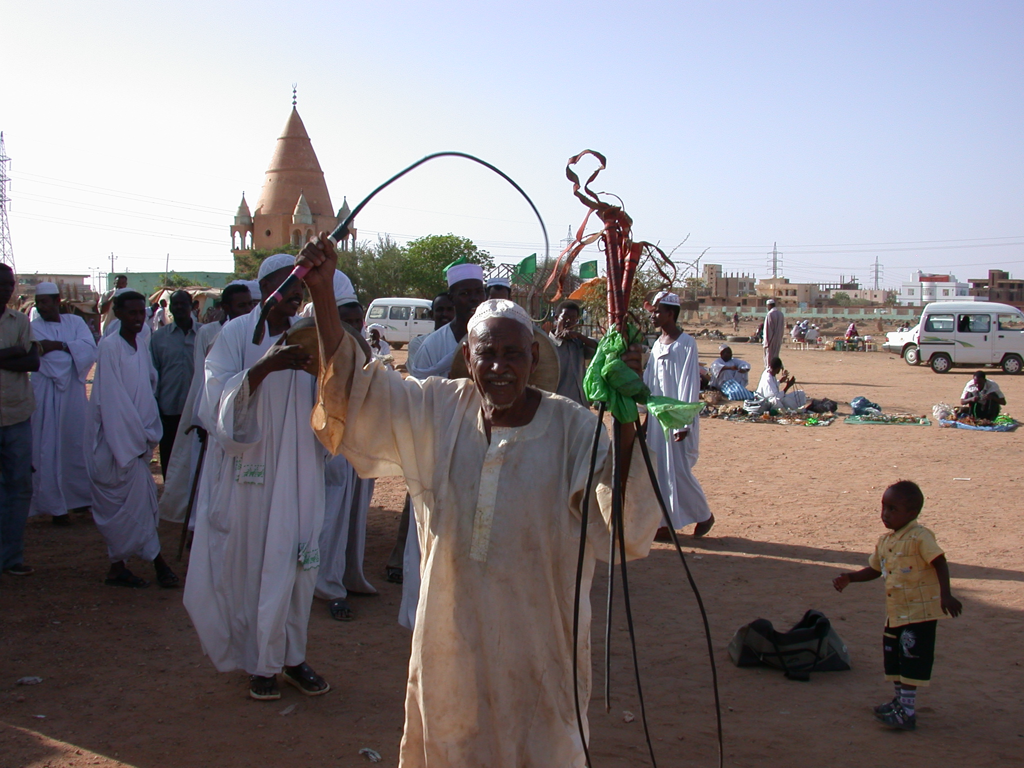 Guy Selling Whips at Sufi Dancing Site, Omdurman, Sudan