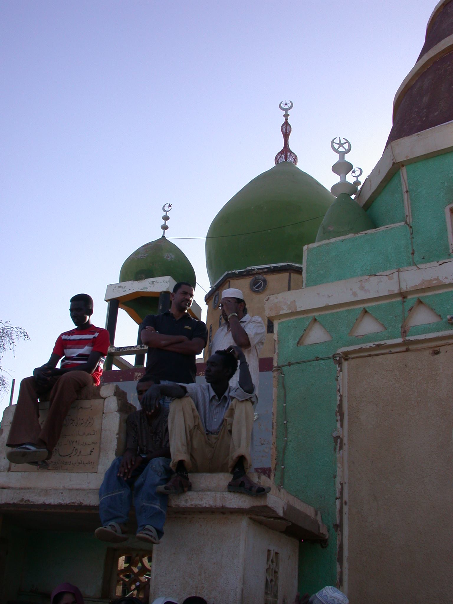 Guys Sitting on Tomb Structures at Sufi Dancing Site, Omdurman, Sudan