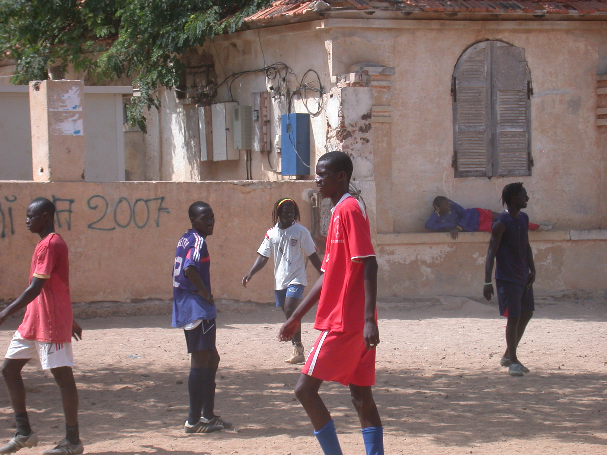 Young Guys Playing Soccer and One With Longhair, Ile de Goree, Dakar, Senegal