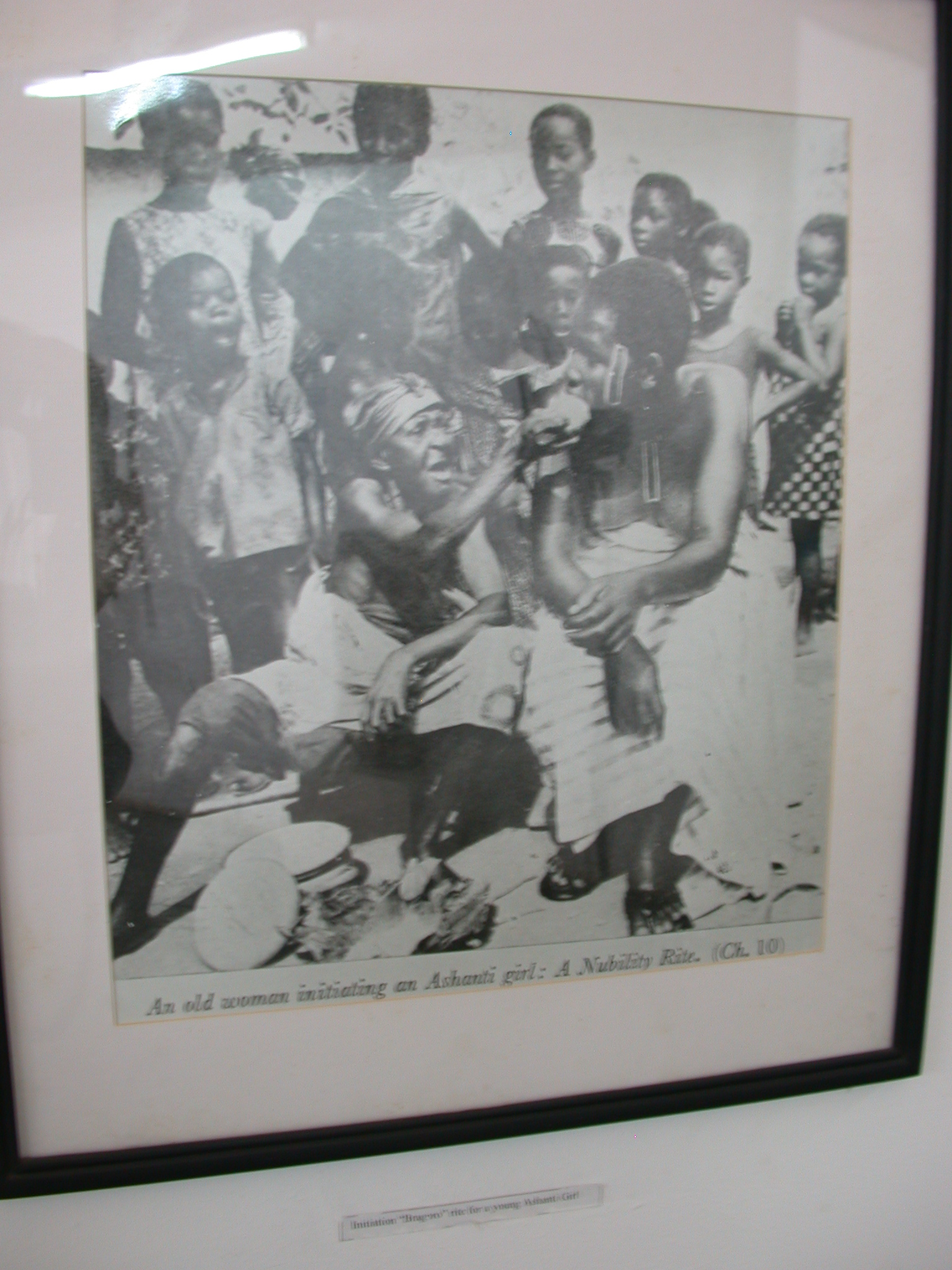Picture of an Old Woman Initiating an Ashanti / Asante Girl, National Museum, Accra, Ghana