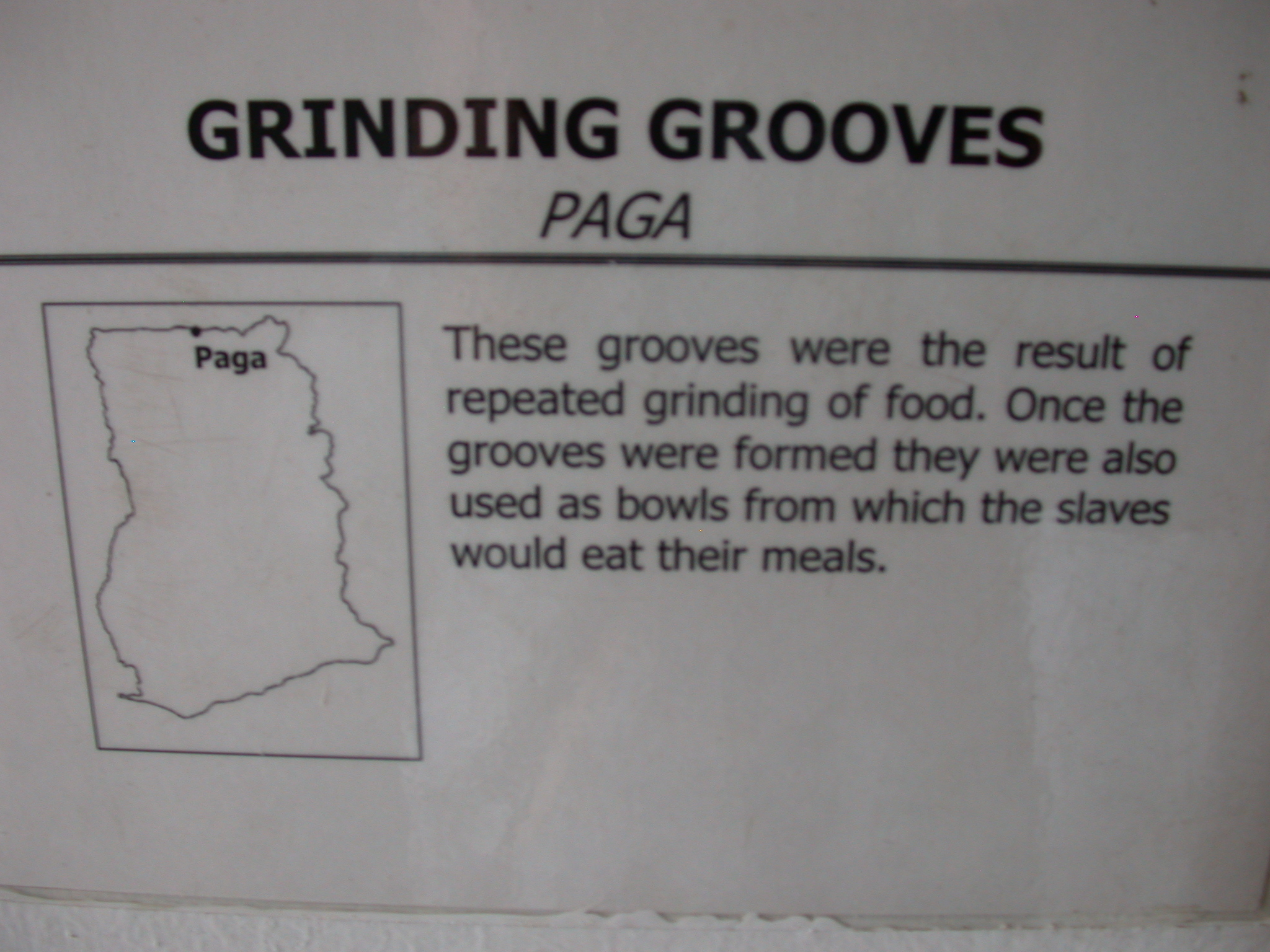 Label for Picture of Grinding Grooves and Slave Bowls, National Museum, Accra, Ghana