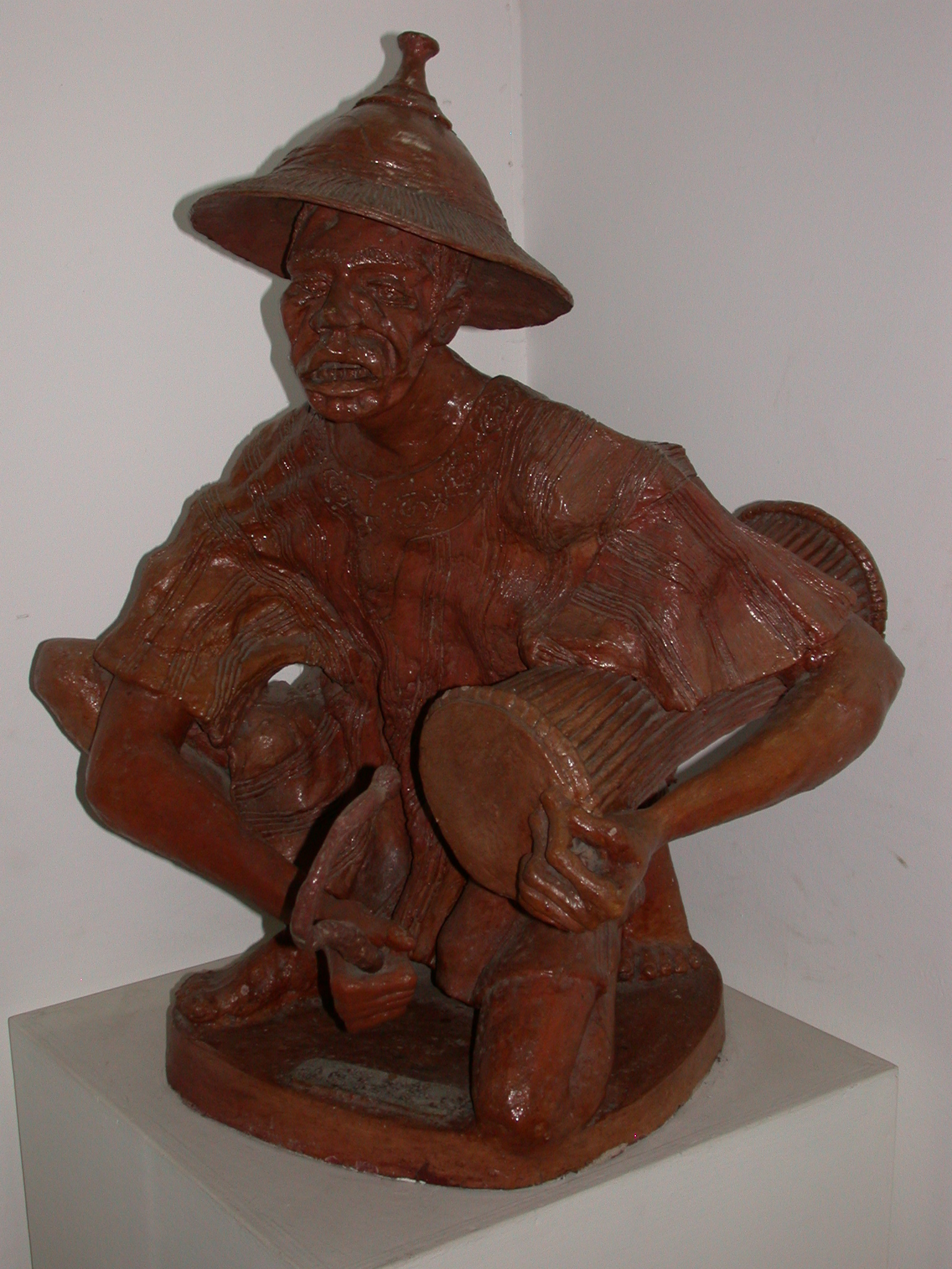 Wooden Sculpture of Man Playing Talking Drum, National Museum, Accra, Ghana
