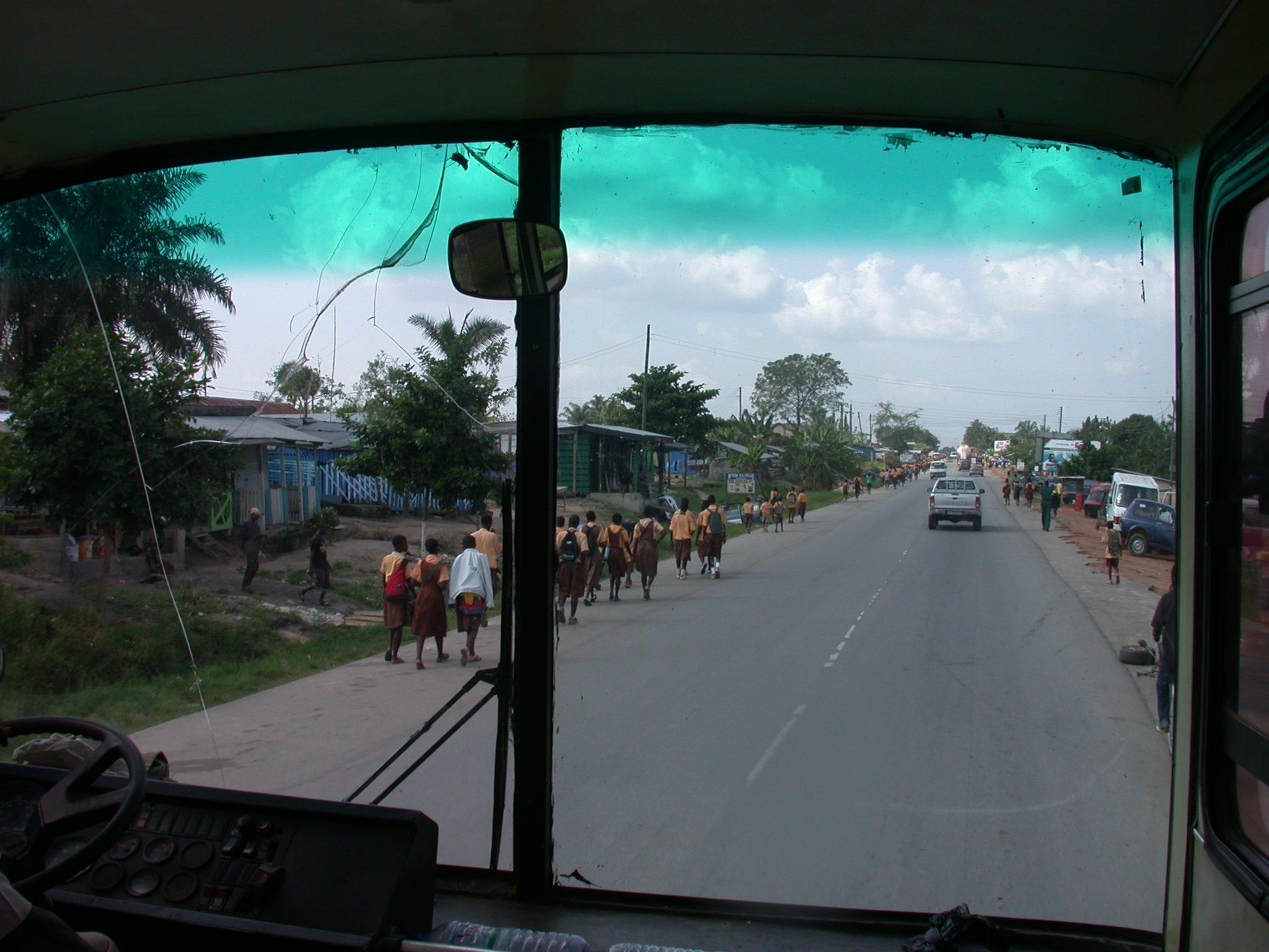 Schoolchildren With Uniforms Viewed Through Bus Window, Road From Cape Coast to Kumasi, Ghana