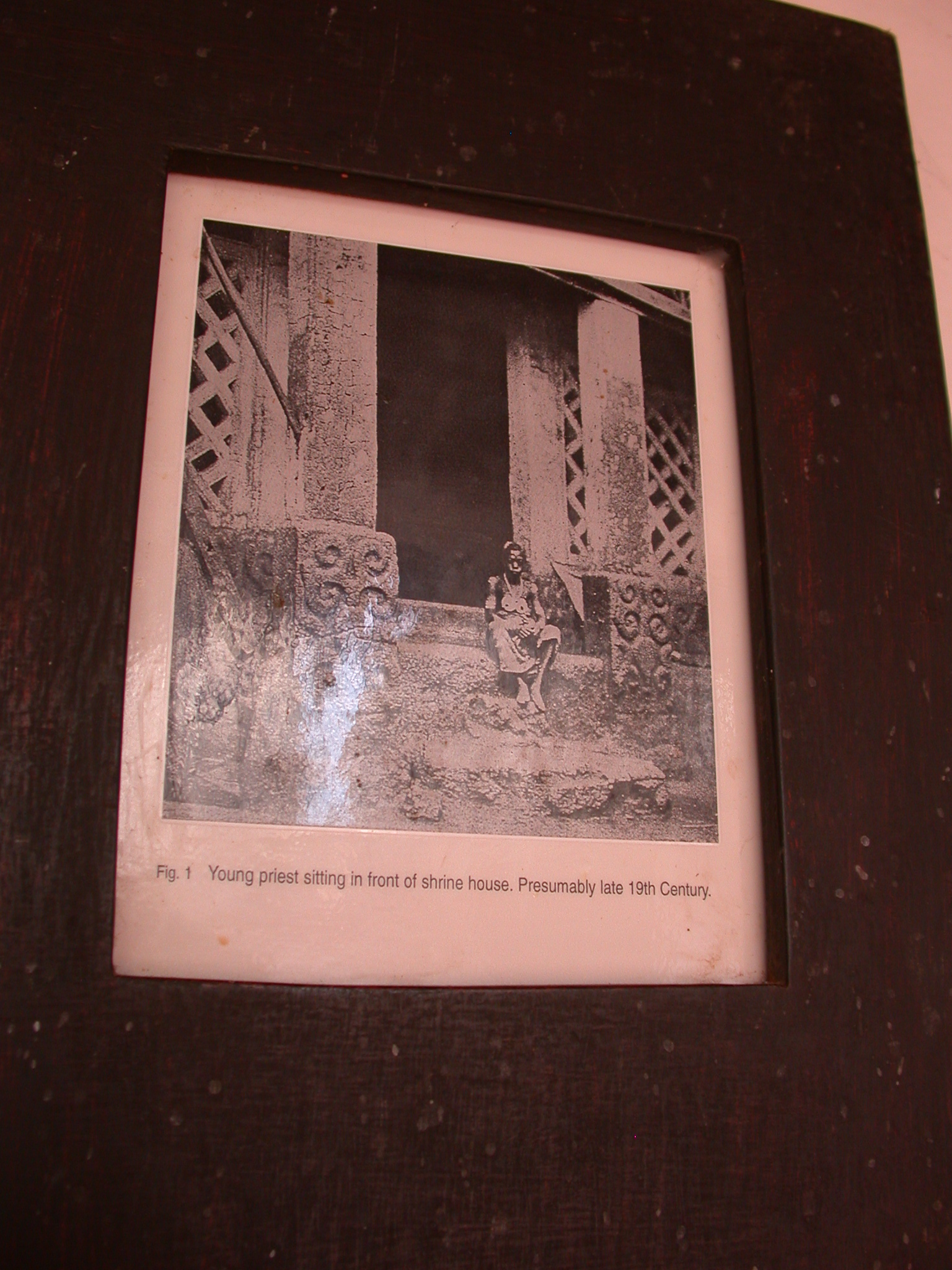 Photograph of Asante Priest in Front of Late 19th Century Shrine, Asante Traditional Shrine at Ejisu-Besease, Ghana