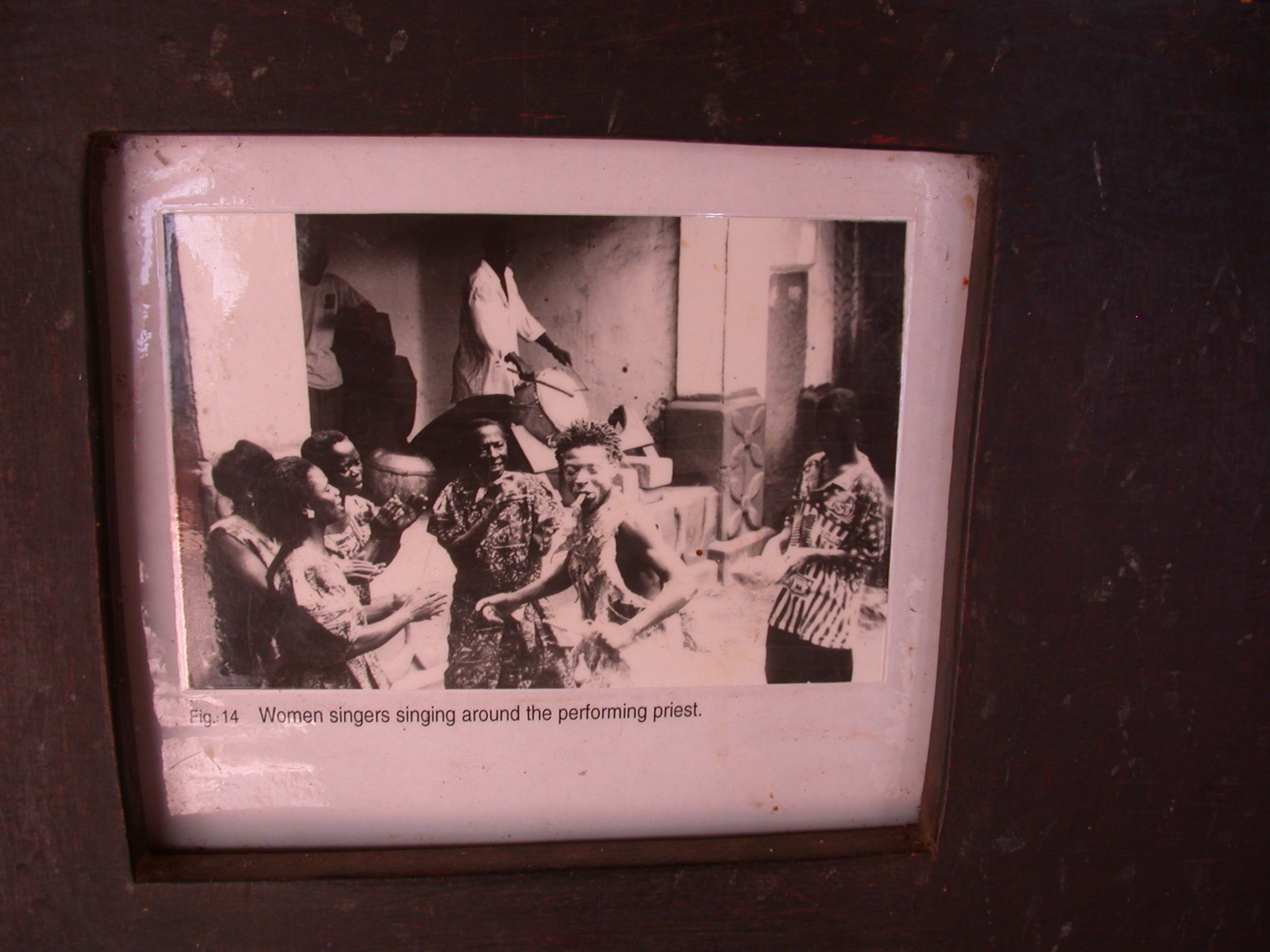 Photograph of Women Singing Around Performing Okomfo, Asante Traditional Shrine at Ejisu-Besease, Ghana