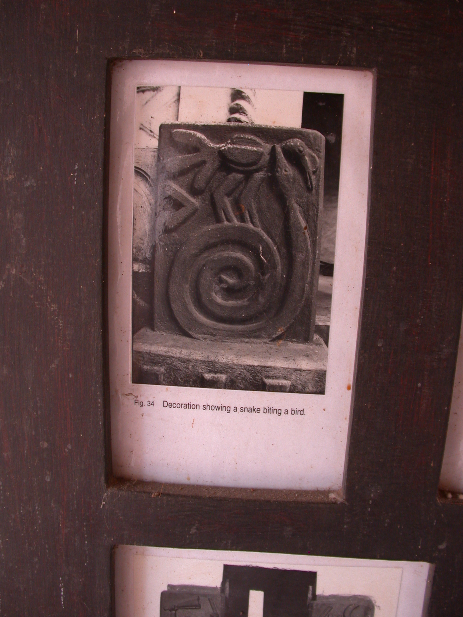 Photograph of Decoration Showing Snake Biting a Bird, Asante Traditional Shrine at Ejisu-Besease, Ghana