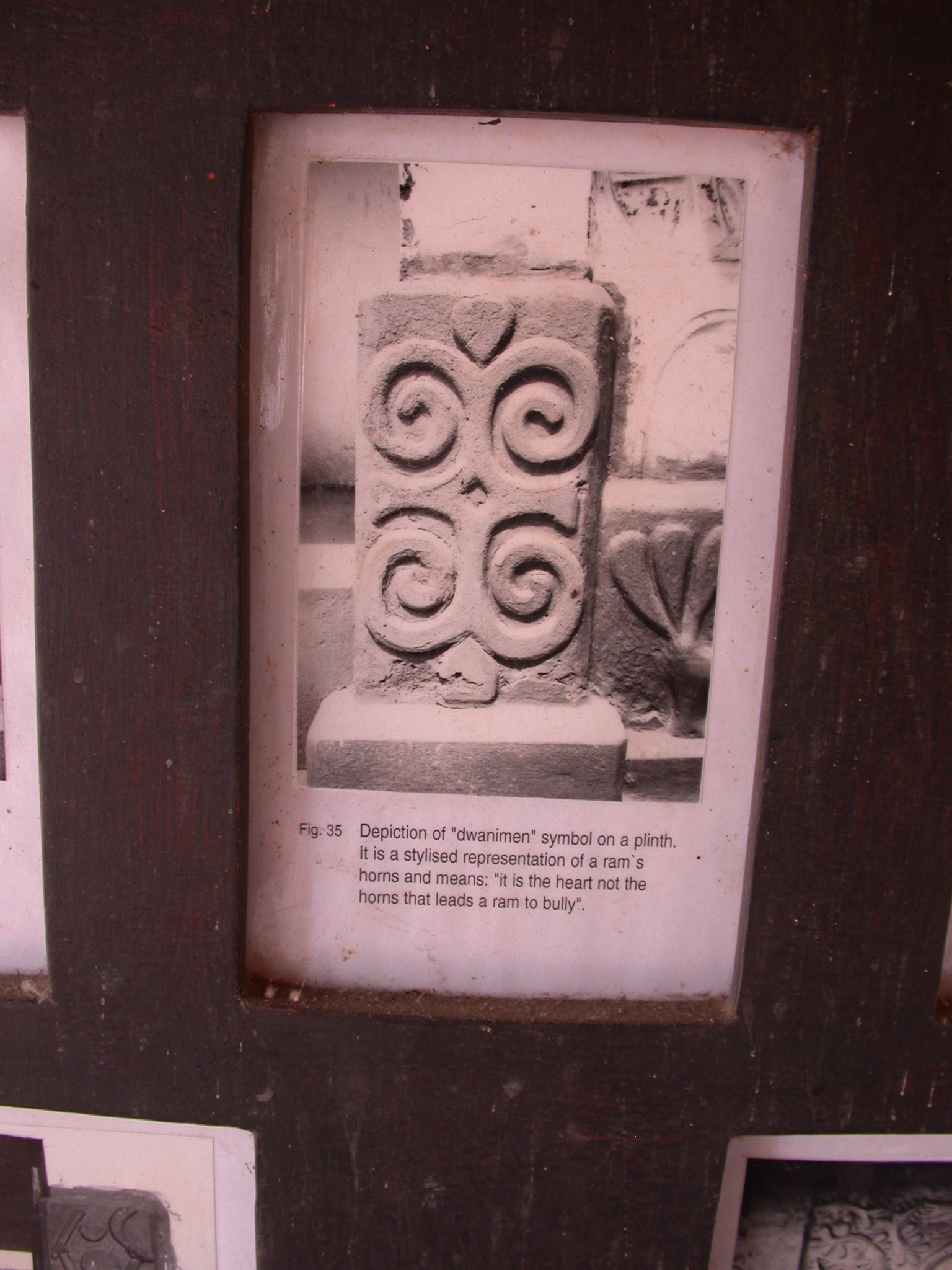 Photograph of Dwanimen Ram Horn Symbol on Plinth Meaning It Is the Heart Not the Horns That Leads a Ram to Bully, Asante Traditional Shrine at Ejisu-Besease, Ghana