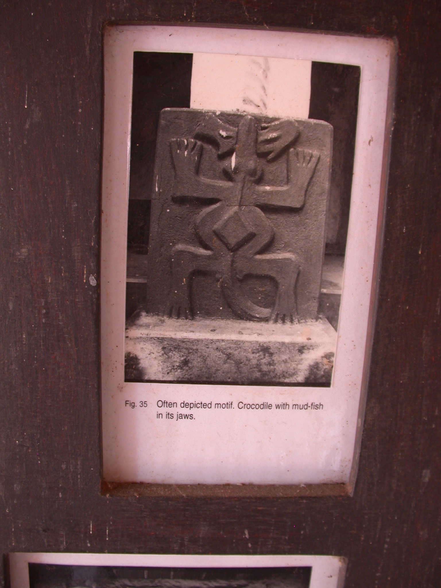 Photograph of Motif of Crocodile With Mudfish in Its Jaws, Asante Traditional Shrine at Ejisu-Besease, Ghana