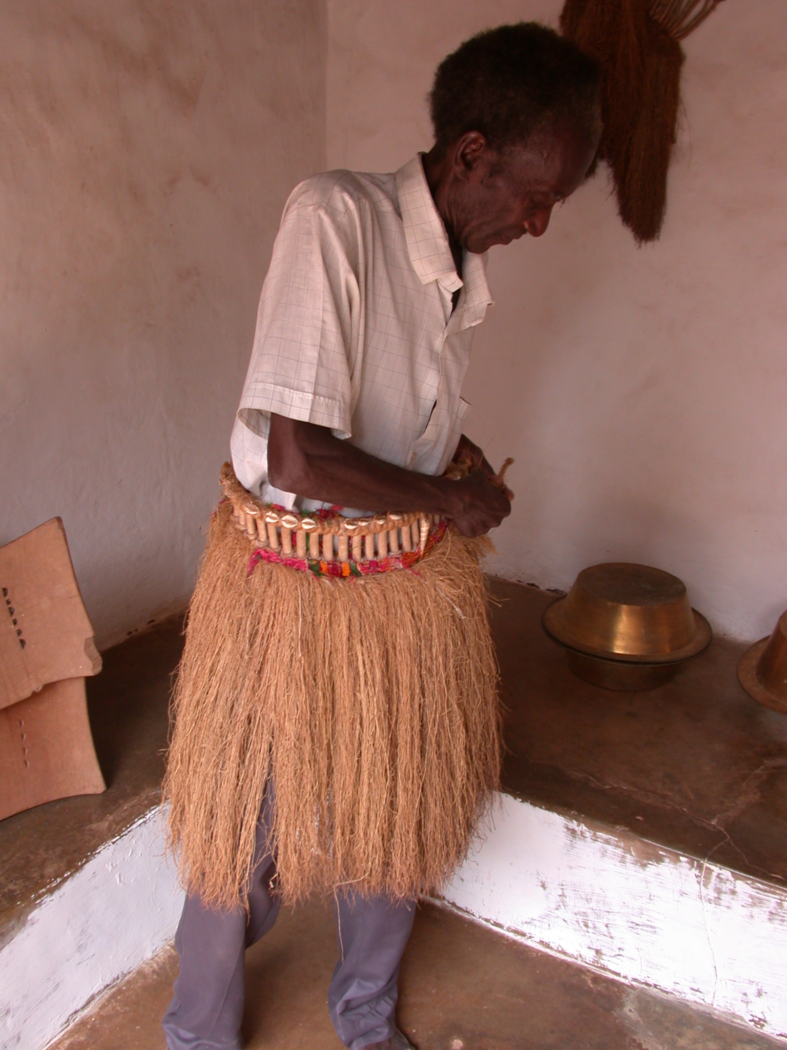 Caretaker Wearing Traditional Raffia Skirt, Asante Traditional Shrine at Ejisu-Besease, Ghana