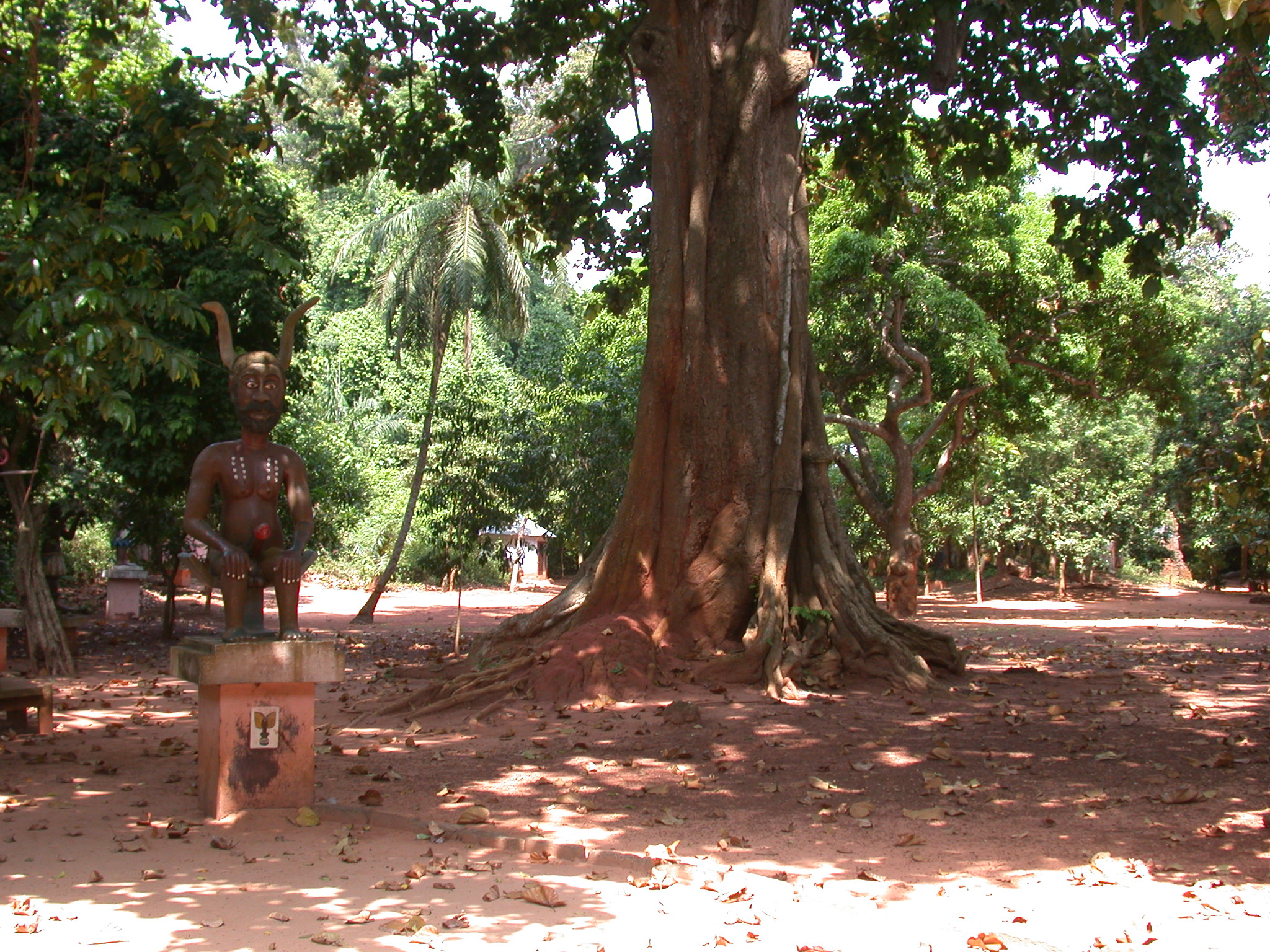 Horned and Phallic Legba Deity Sculpture and Large Tree, Kpasse Sacred Forest, Ouidah, Benin