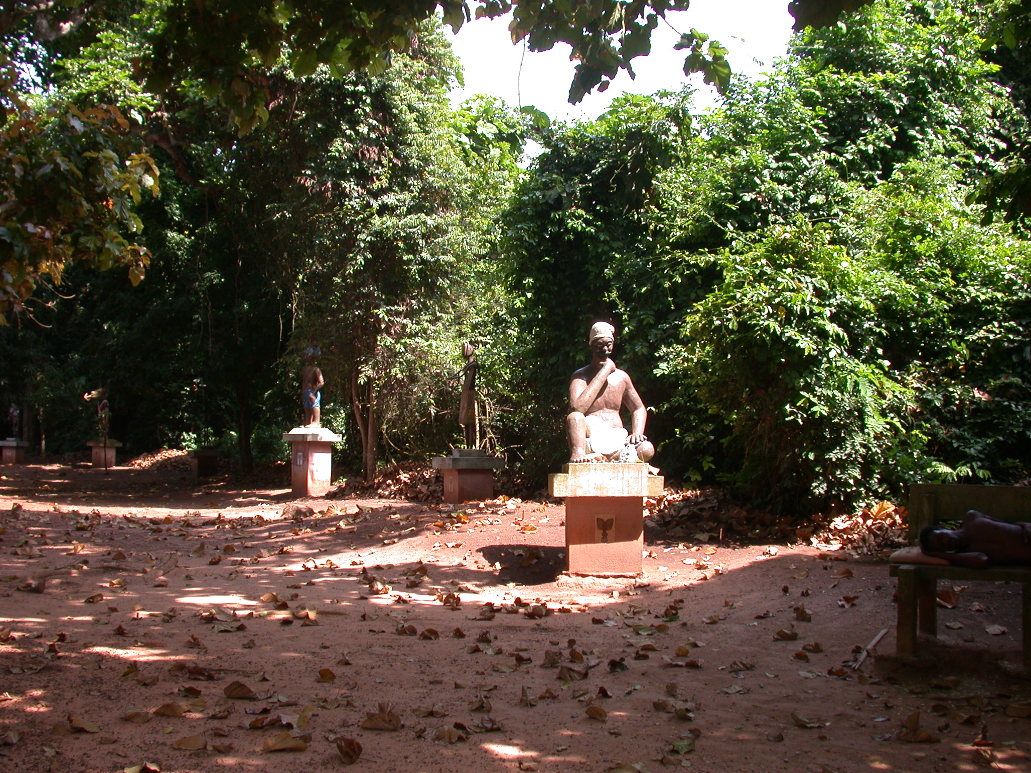 Bokonon Fa Diviner and Other Sculptures, Kpasse Sacred Forest, Ouidah, Benin
