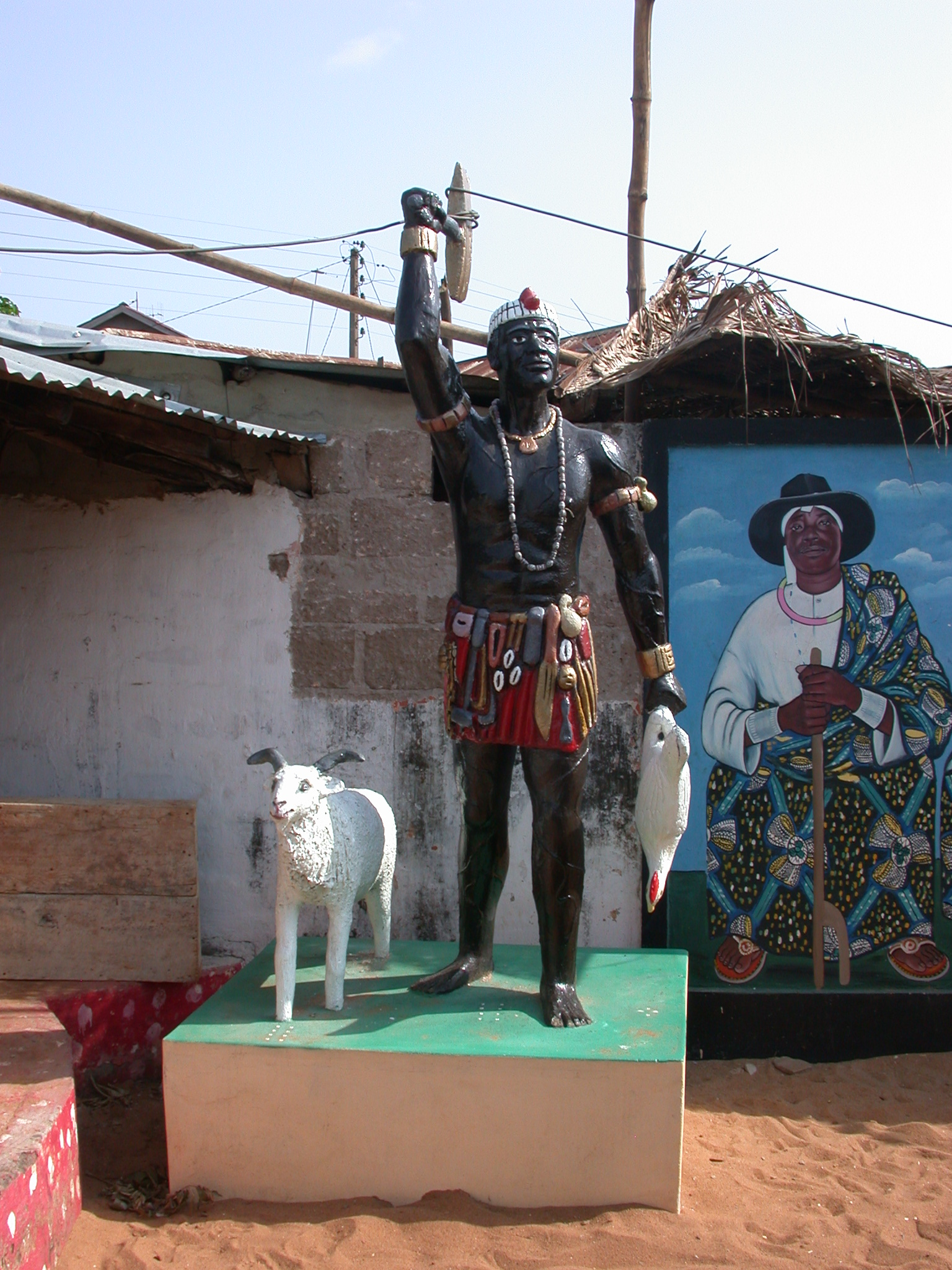 Statue With Ram and Chicken Sacrifice Next to Daagbo Hounon Portrait, Daagbo Hounon Dodo Palace, Ouidah, Benin