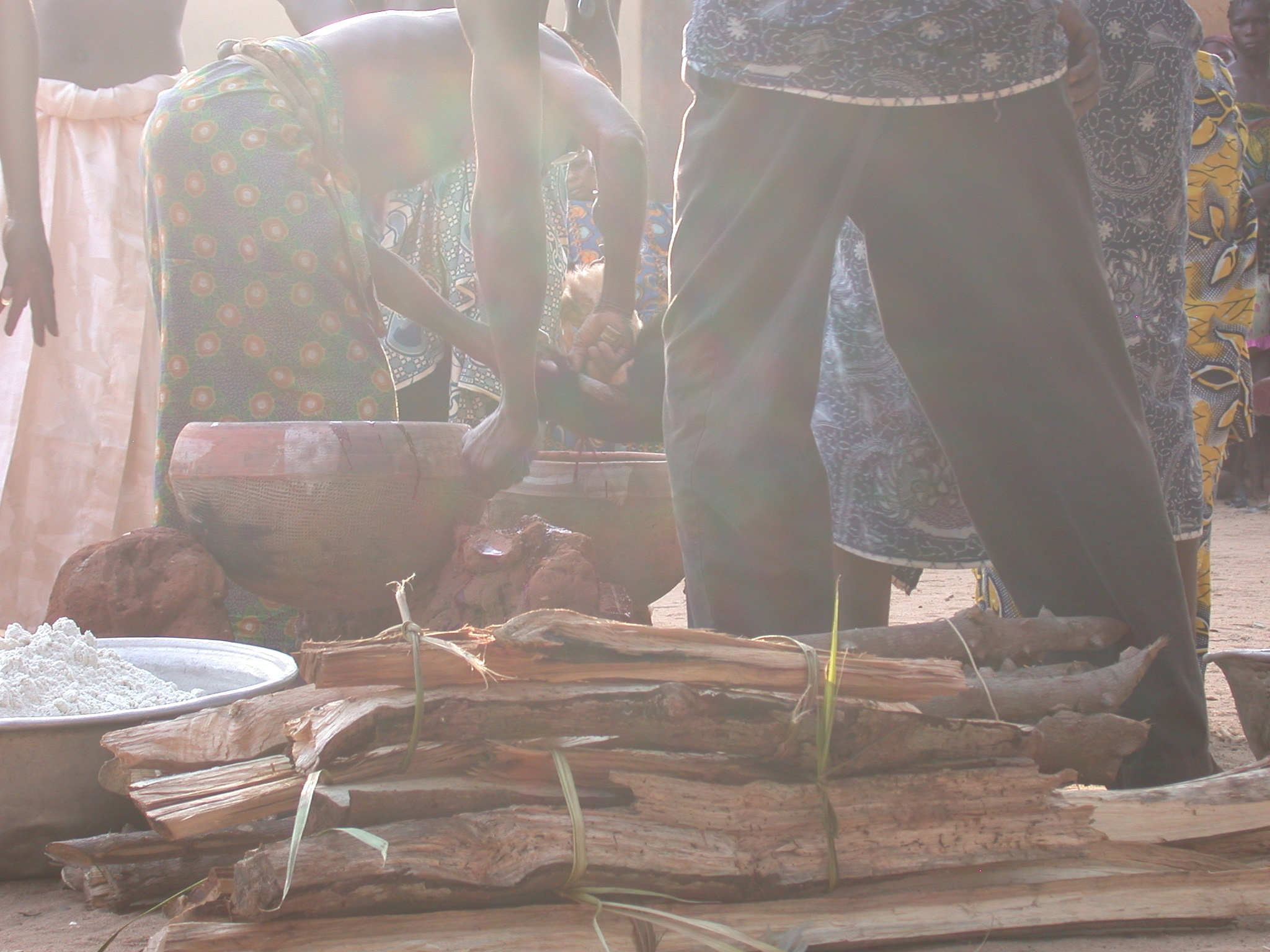 Gathering Sacrificial Goat Blood in Ceramic Pots, Vodun Ritual, Ouidah, Benin