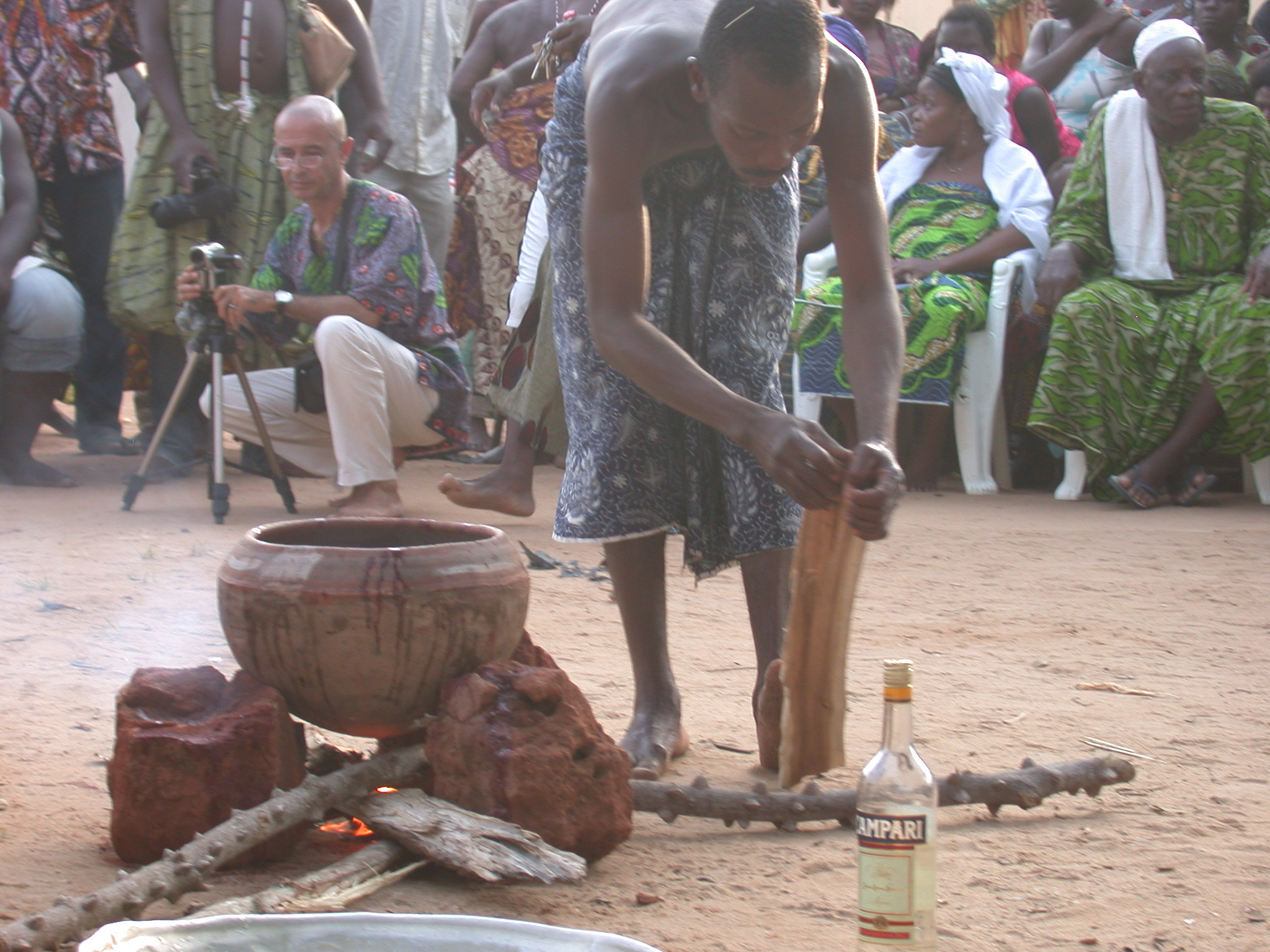 Preparing Fire for Cooking of Sacrificial Meat, Vodun Ritual, Ouidah, Benin