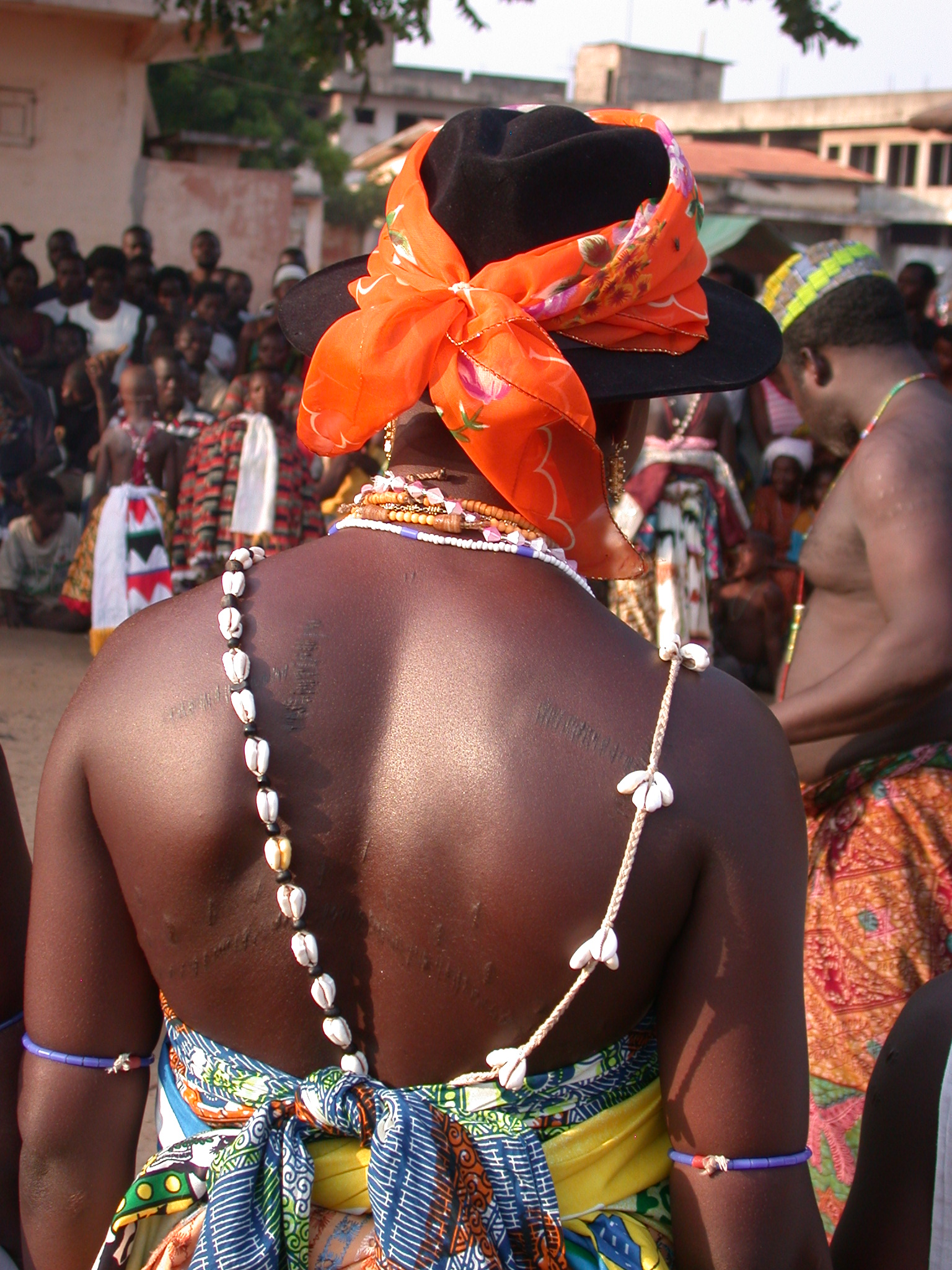 Woman With Scarred Back Watching Vodun Ritual, Ouidah, Benin