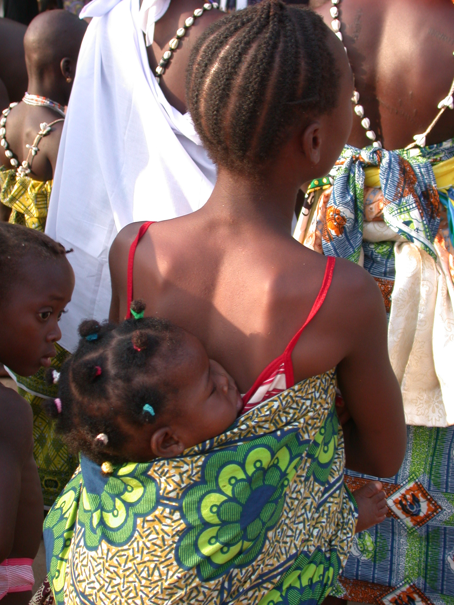 Girl Holding Baby on Back in Traditional Cloth, Vodun Ritual, Ouidah, Benin