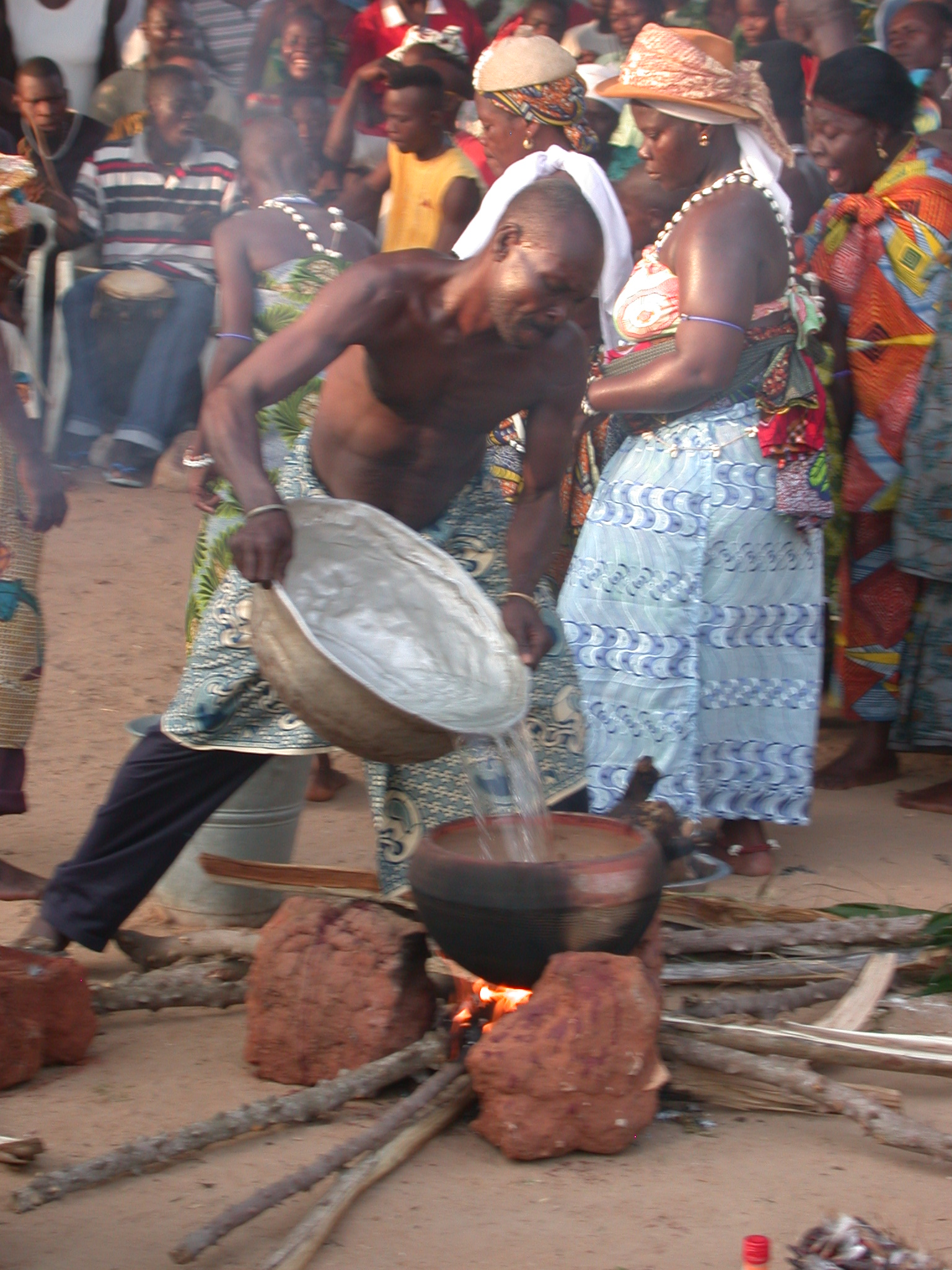 Adding Water to Cooking Sacrifice, Vodun Ritual, Ouidah, Benin