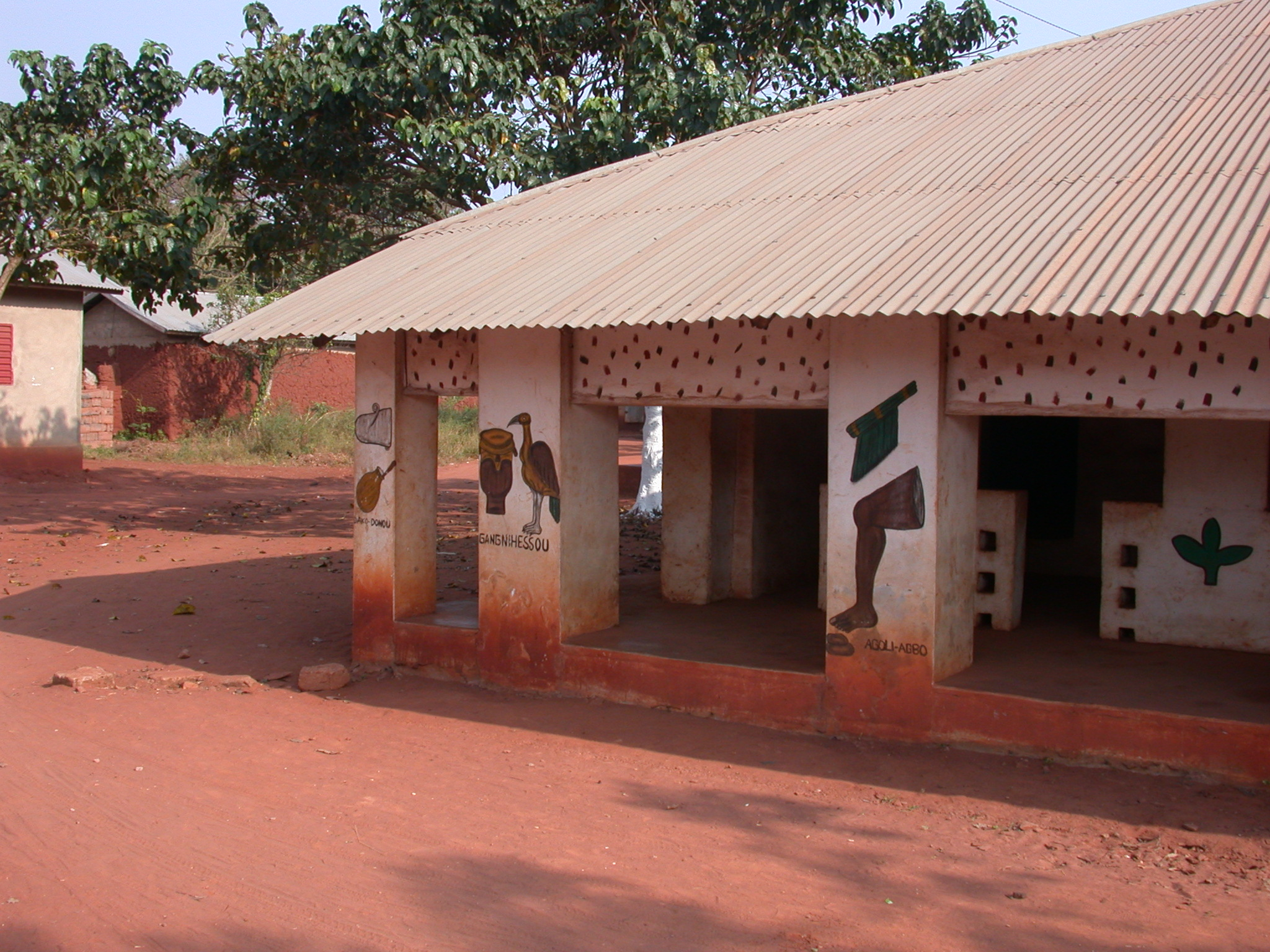 Left Side of Zomadonou Akaba Temple With Symbols of  Dako-Donou, Gangnihessou, and Agoli-Agbo, Abomey, Benin