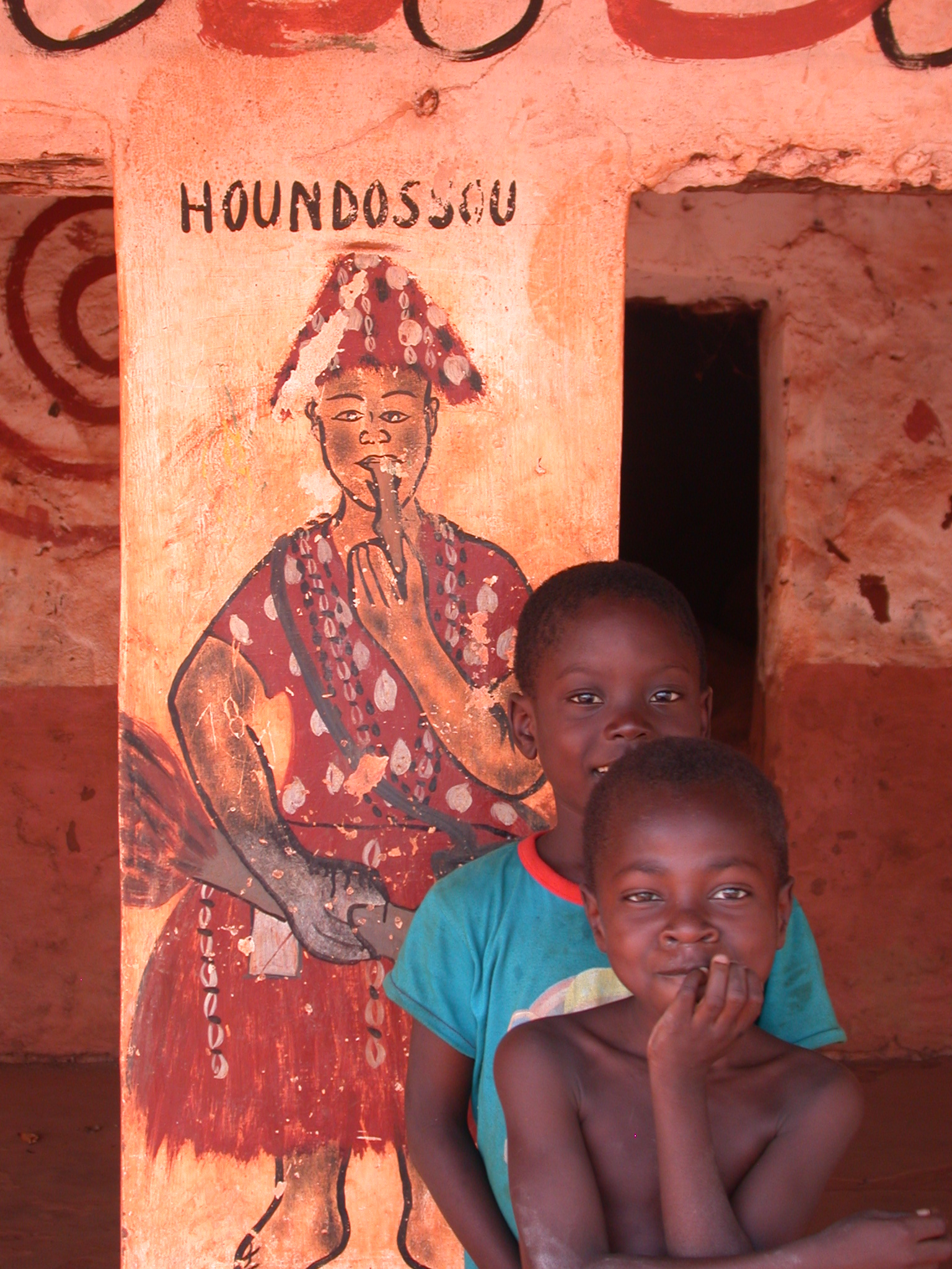 Two Cute Children in Front of Hondossou Painting on Compound Pillar, Houemou Agonglo Temple, Abomey, Benin
