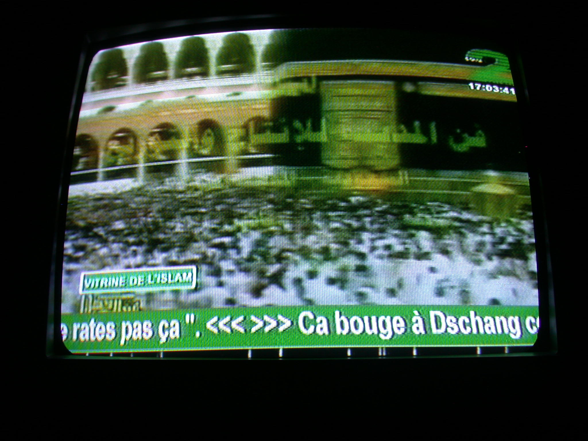 Hajj Pilgrims Circle Kaaba in Mecca on French-Advertised Television, Abomey, Benin
