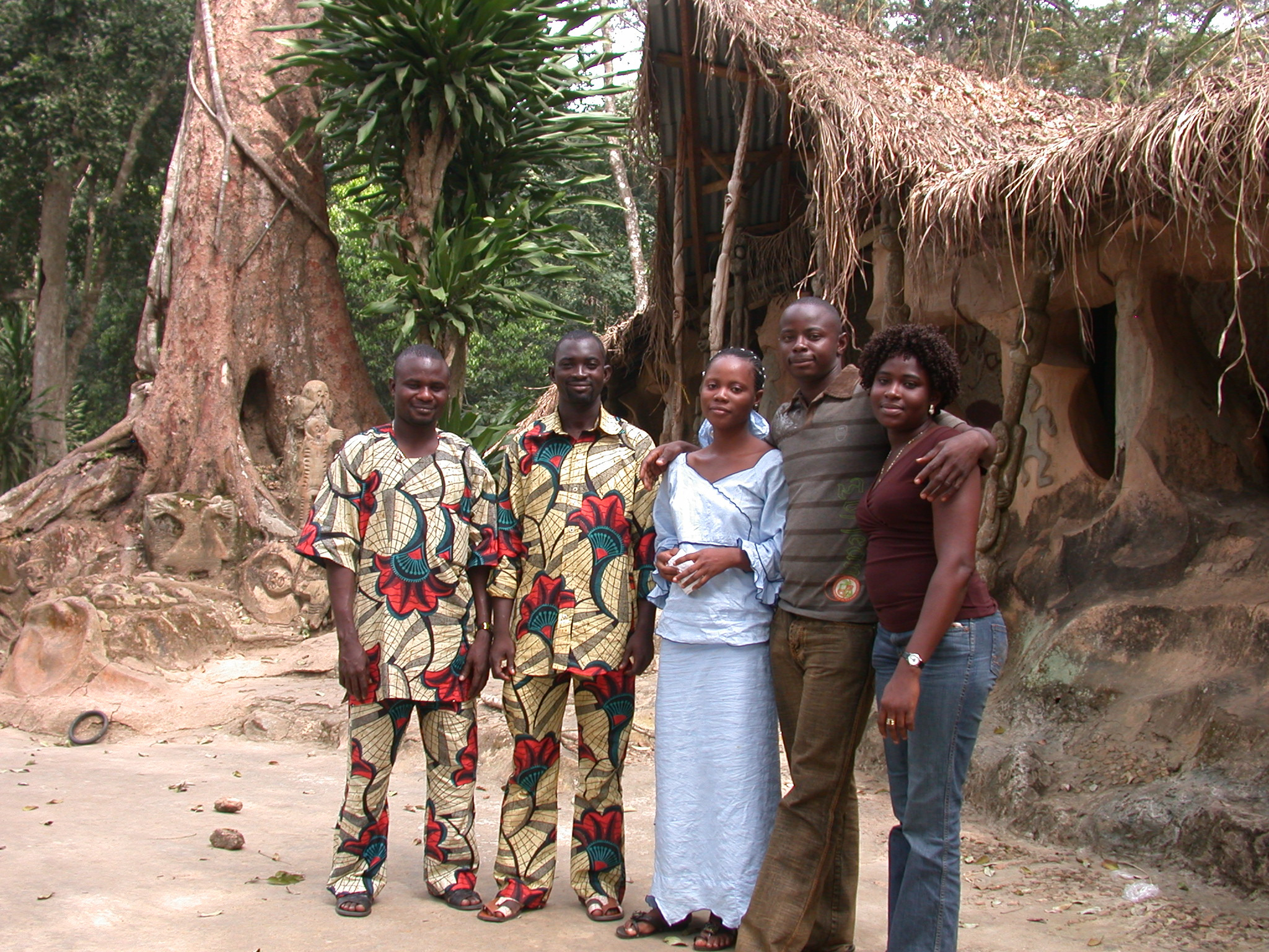 Nigerian Tourists in Front of Thatched Ceremonial Home, Osun Sacred Grove, Oshogbo, Nigeria
