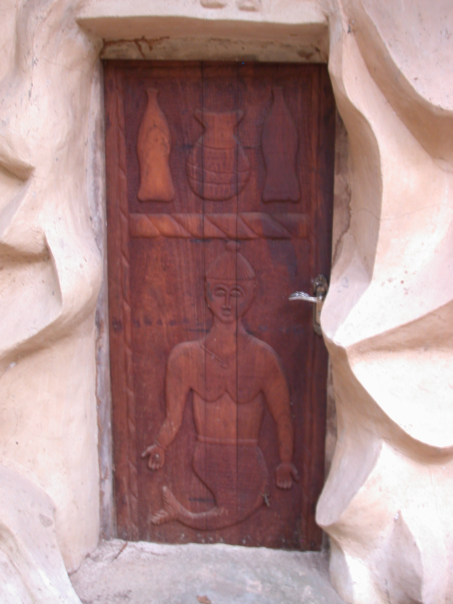 Closeup of Carved Wooden Door, Meeting Building, Osun Sacred Grove, Oshogbo, Nigeria