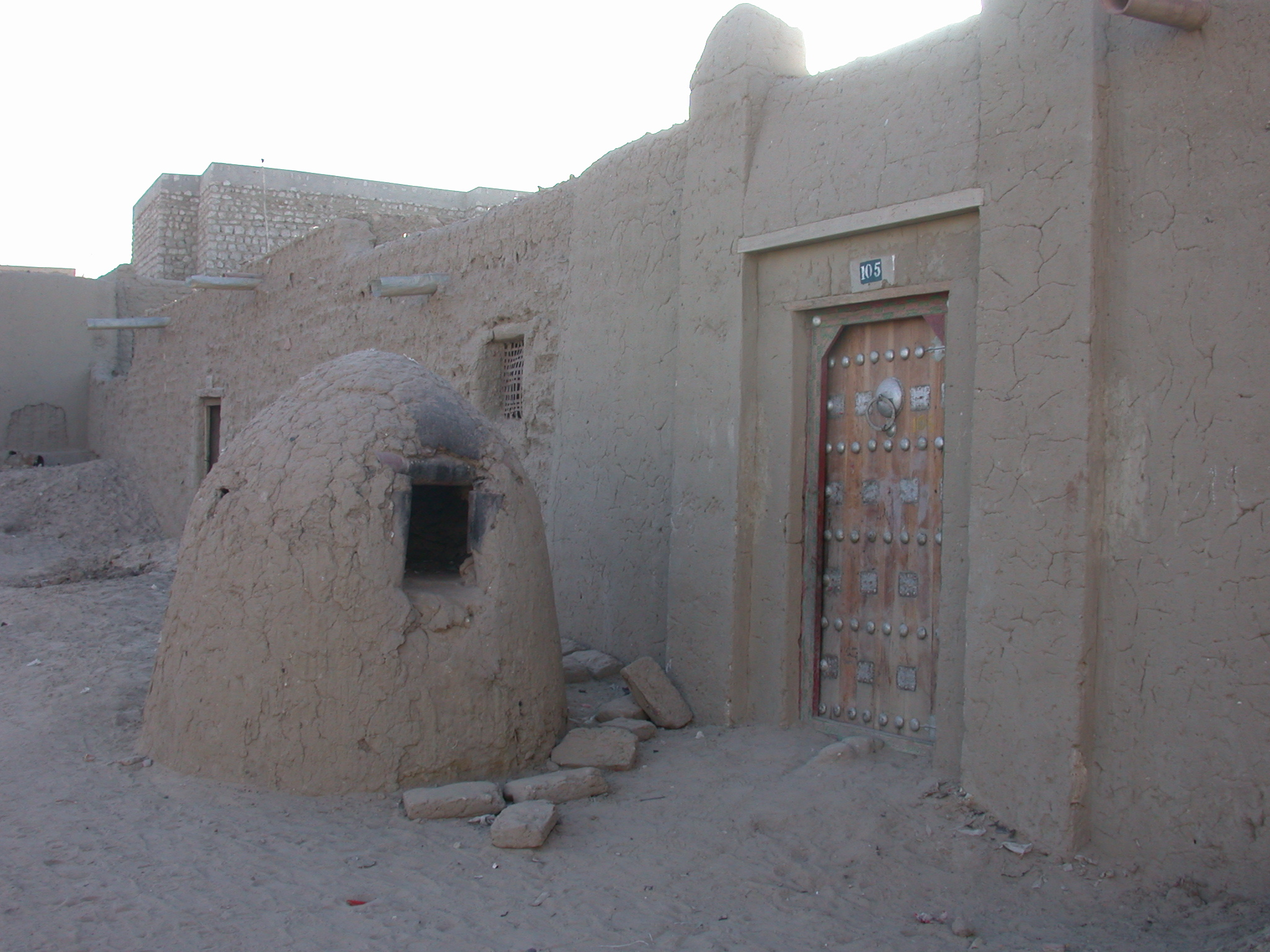 Traditional Oven and Ornamented Wooden Door on Building Near Sankore Mosque, Timbuktu, Mali