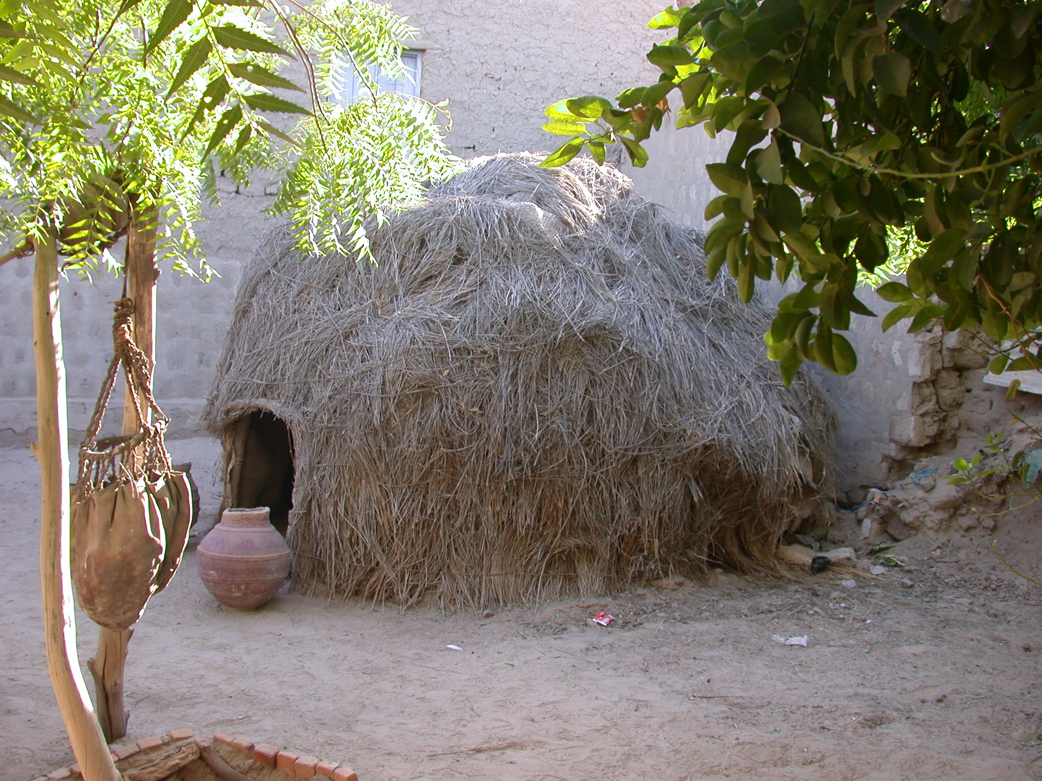Water Bag and Thatch Hut at Reputed Site of Well of Boctou Whence Timbuktu Got Its Name, Timbuktu, Mali