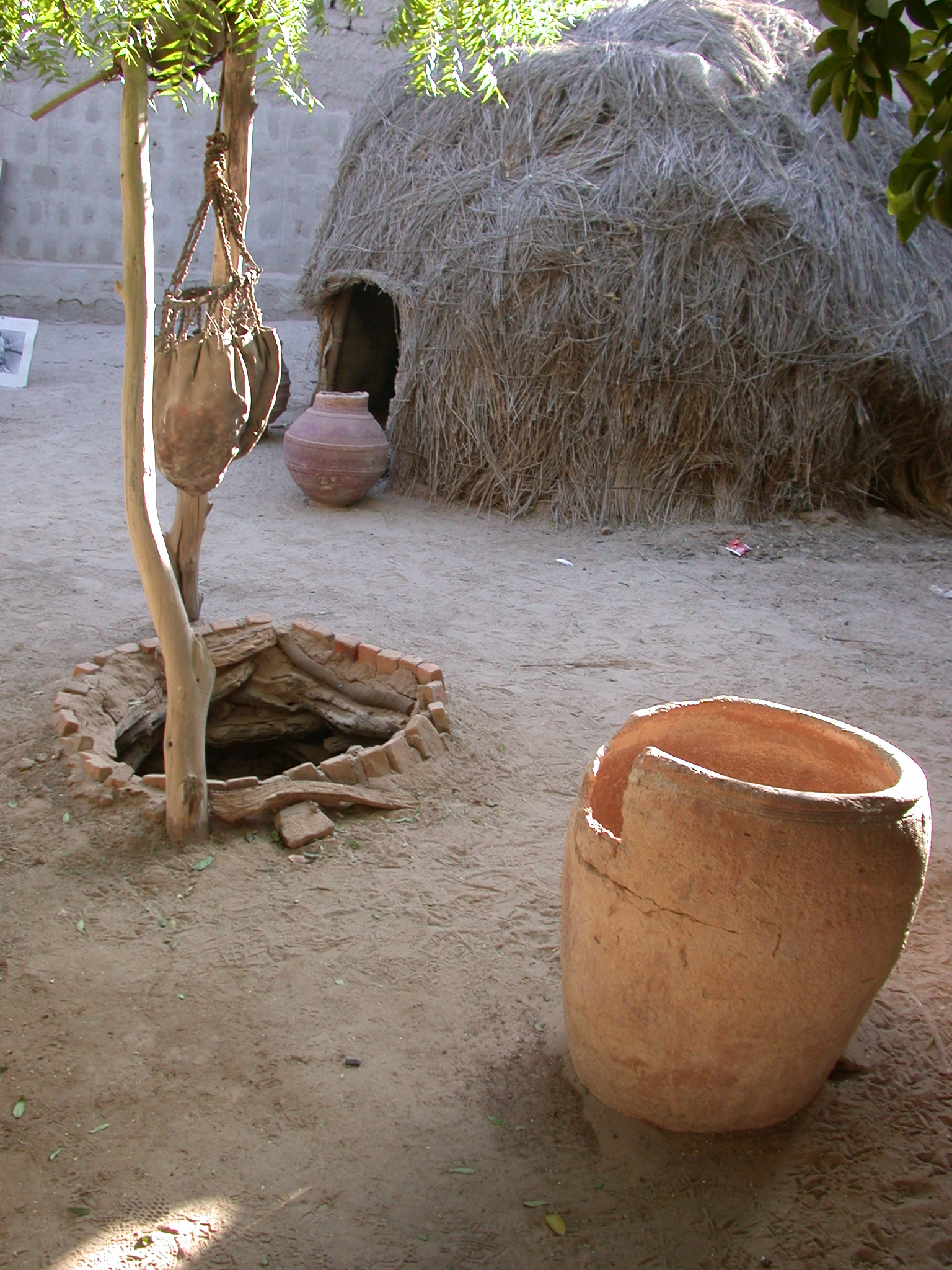 Water Bag, Well Replica, and Thatch Hut at Reputed Site of Well of Boctou Whence Timbuktu Got Its Name, Timbuktu, Mali