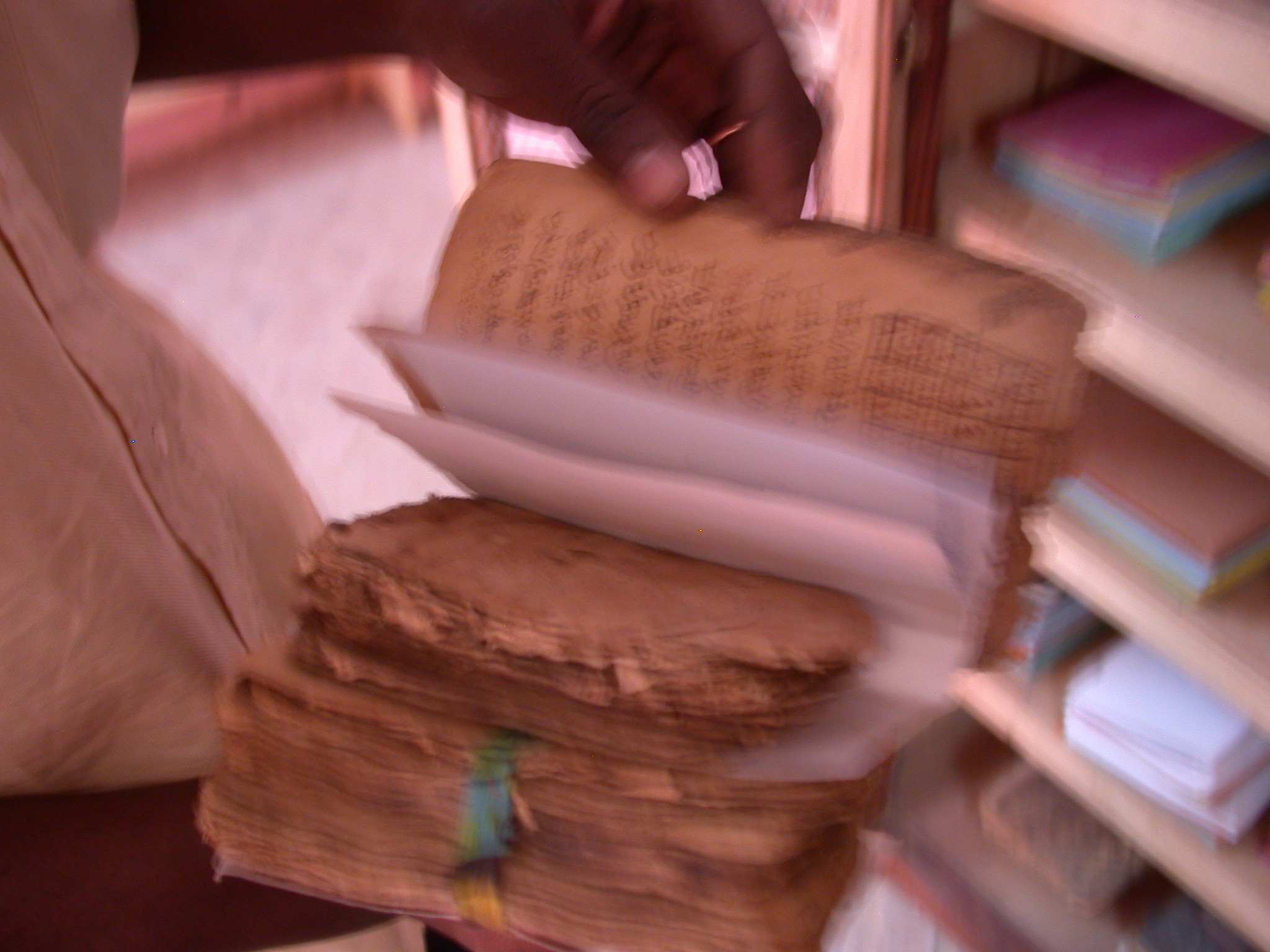 Leafing Through Old Manuscript, Manuscript Library, Timbuktu, Mali