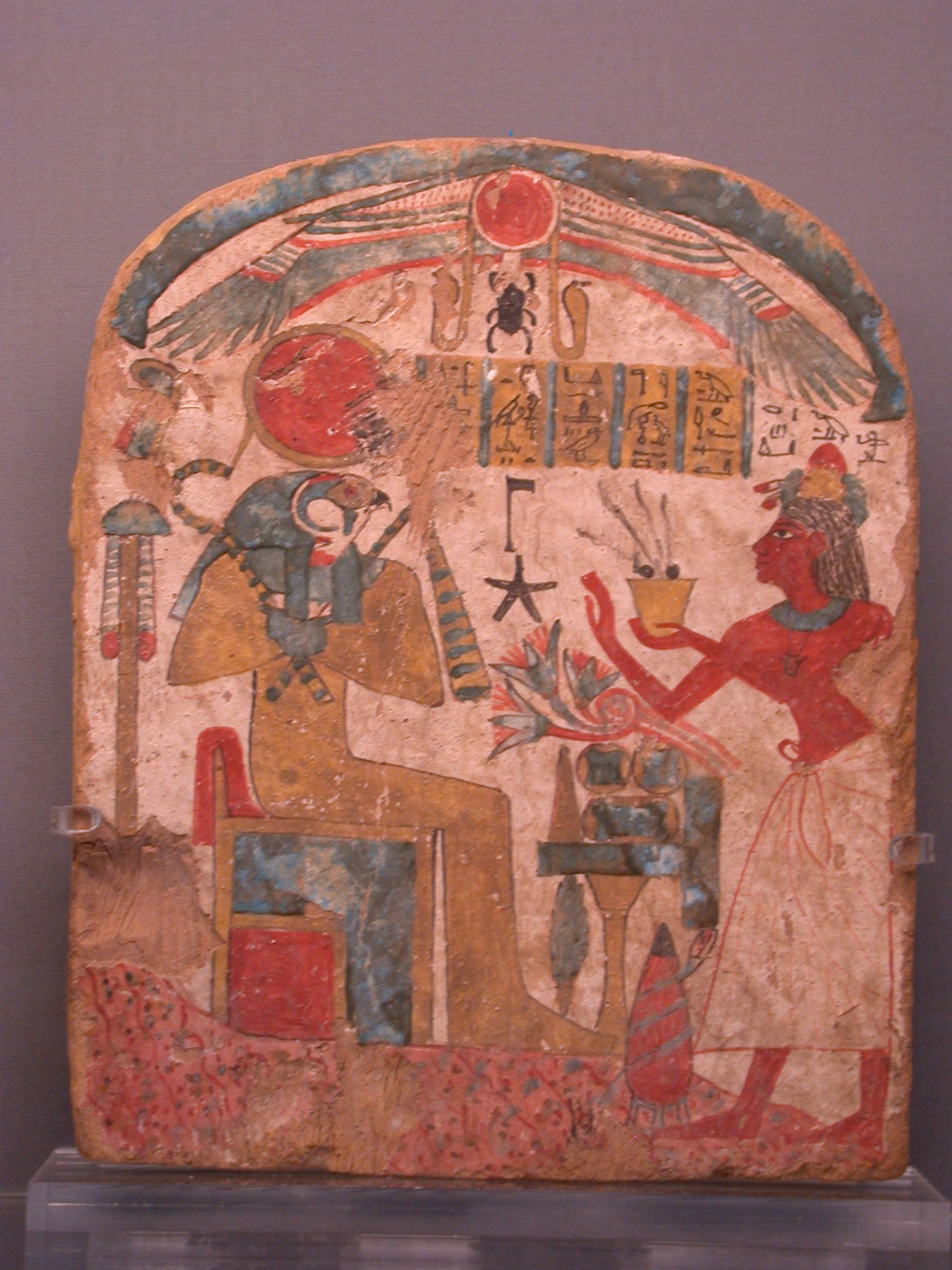 Painted Wood Stela of Woman Offering to Re-Harakhty, Sun God of the Underworld, 22nd Dynasty Egypt, at Fitzwilliam Museum, Cambridge, England
