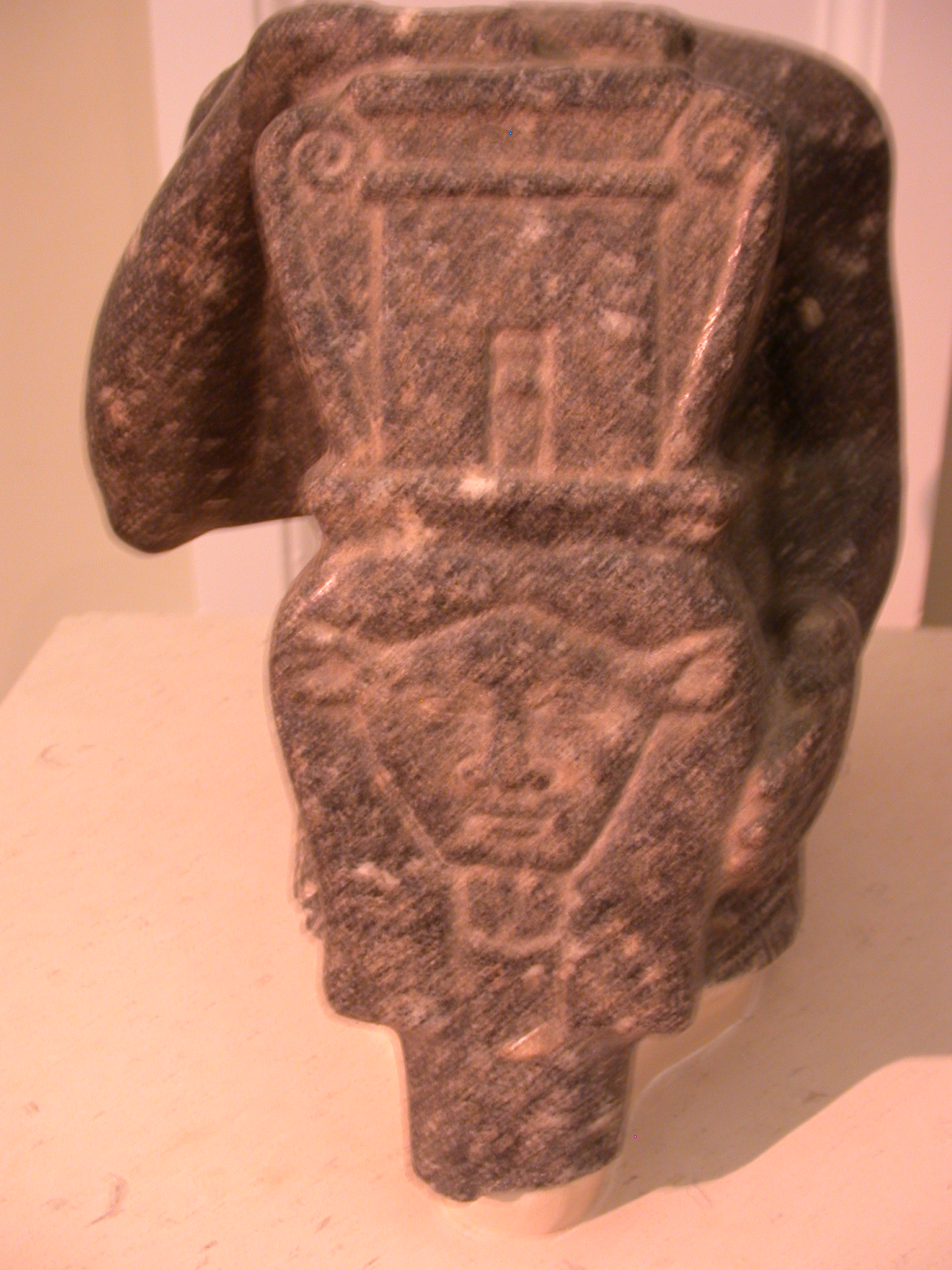 Statue of Priest Holding Large Sistrum in Form of Hathor, Granite, Late Period, 746-336 BCE, Mendes, Egypt, in Fitzwilliam Museum, Cambridge, England