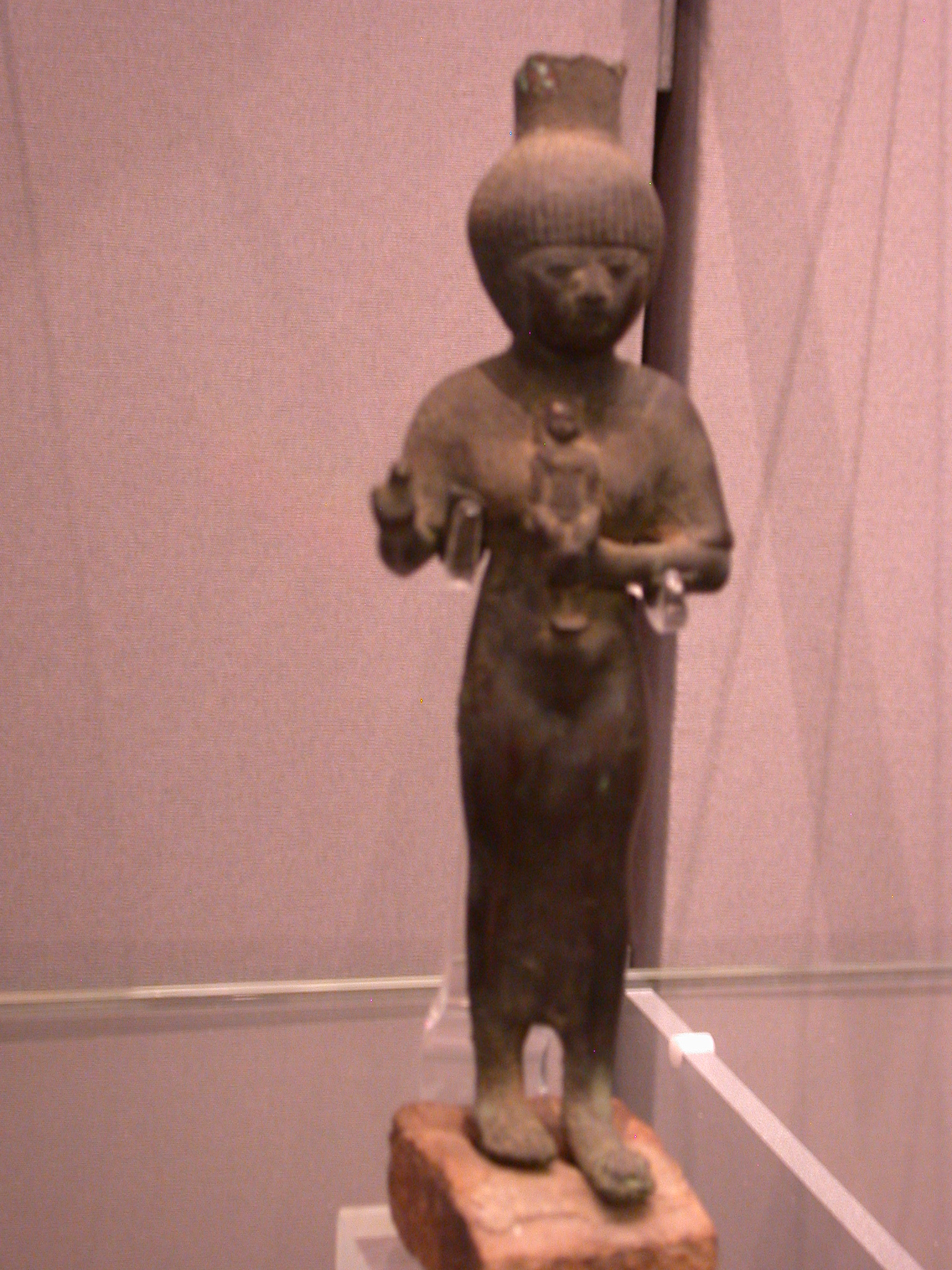 Figurine of Woman Holding Statue of Young Horus, Copper Alloy, 25th Dynasty, 746-664 BCE, Egypt, in Fitzwilliam Museum, Cambridge, England