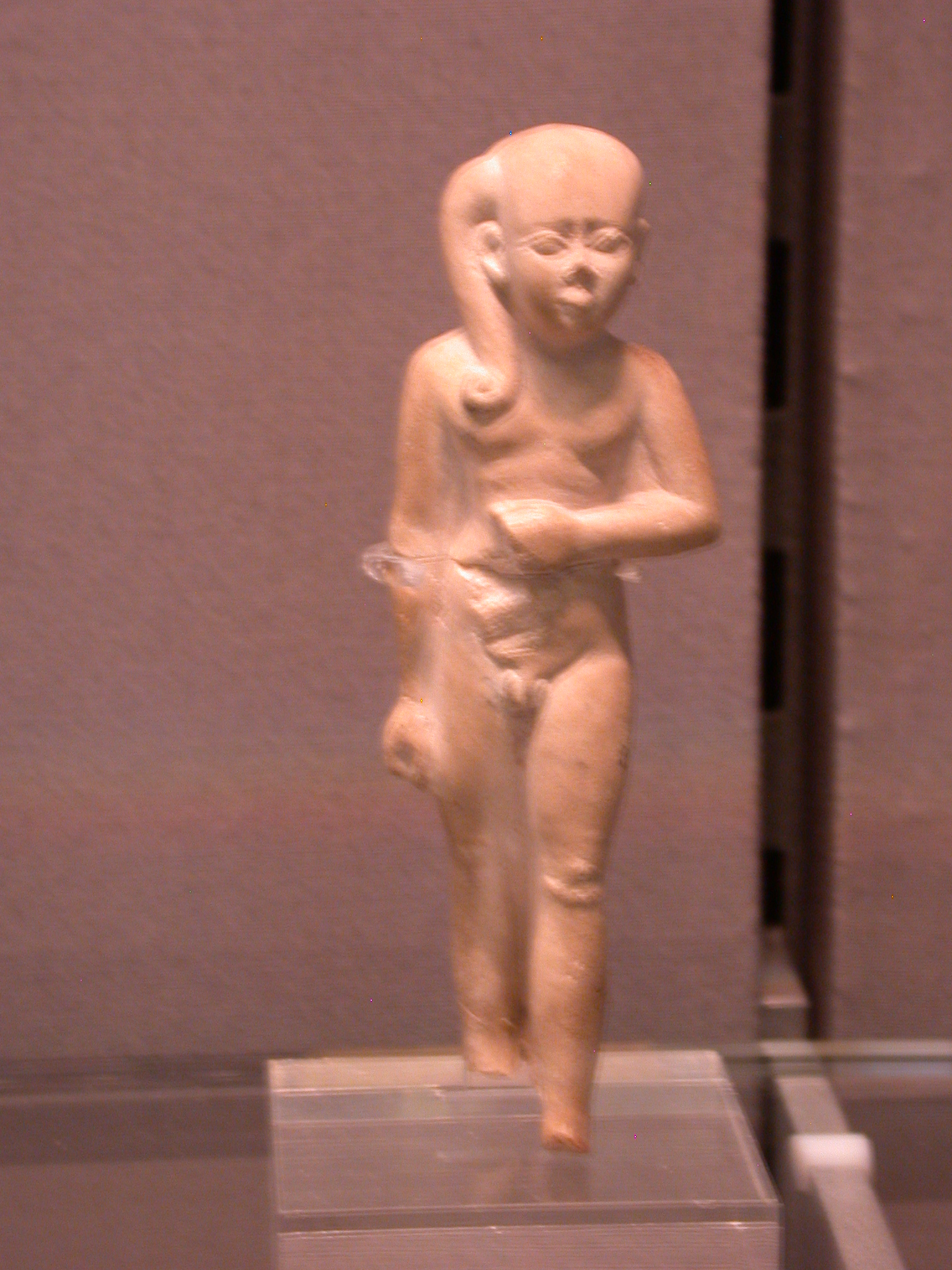 Statuette of Boy Prince or Harpocrates, Limestone, Second Century BCE, Egypt, in Fitzwilliam Museum, Cambridge, England